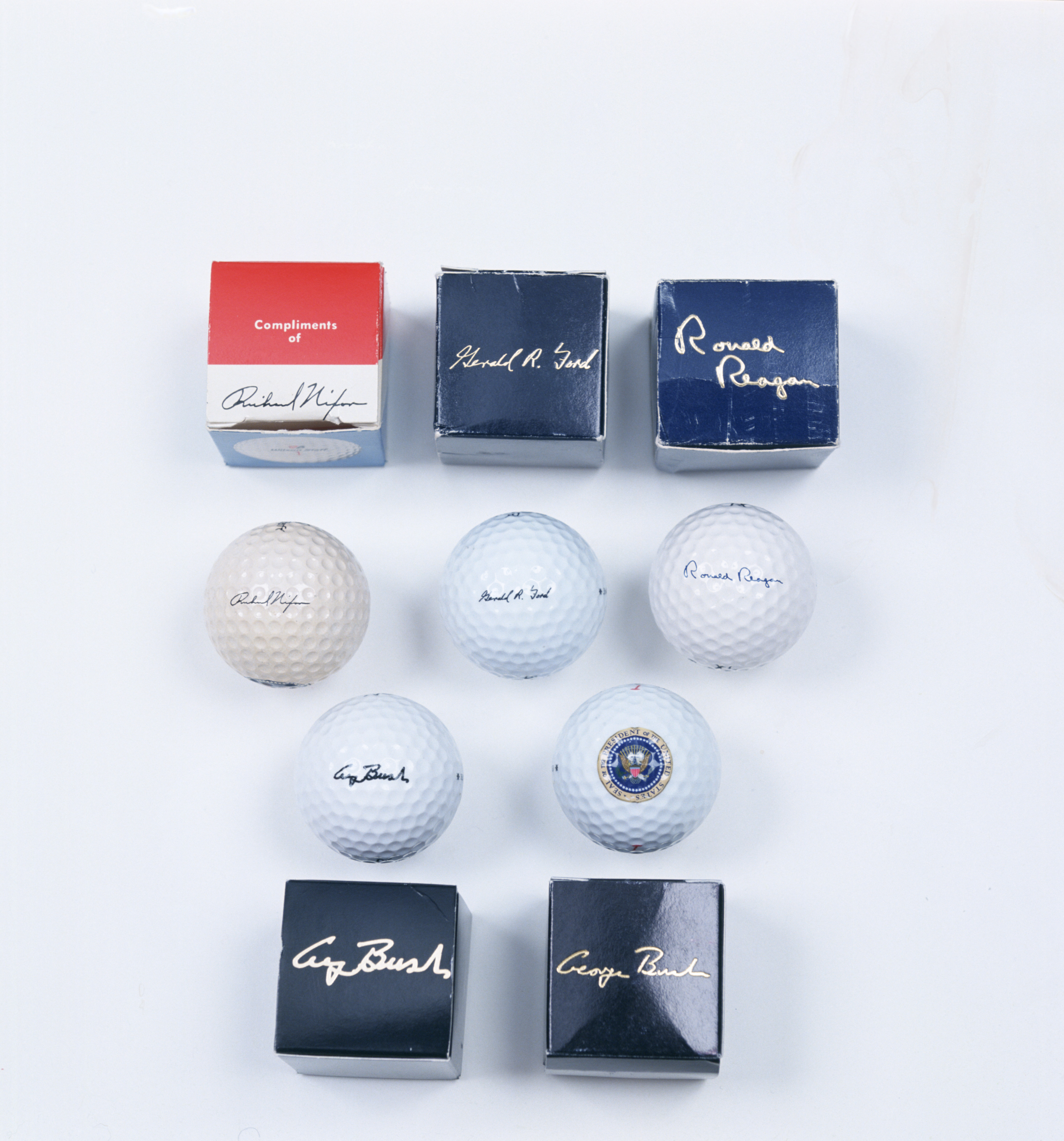 Presidential golf balls and boxes signed by Richard Nixon, Gerald Ford, Ronald Reagan and George Bush senior.