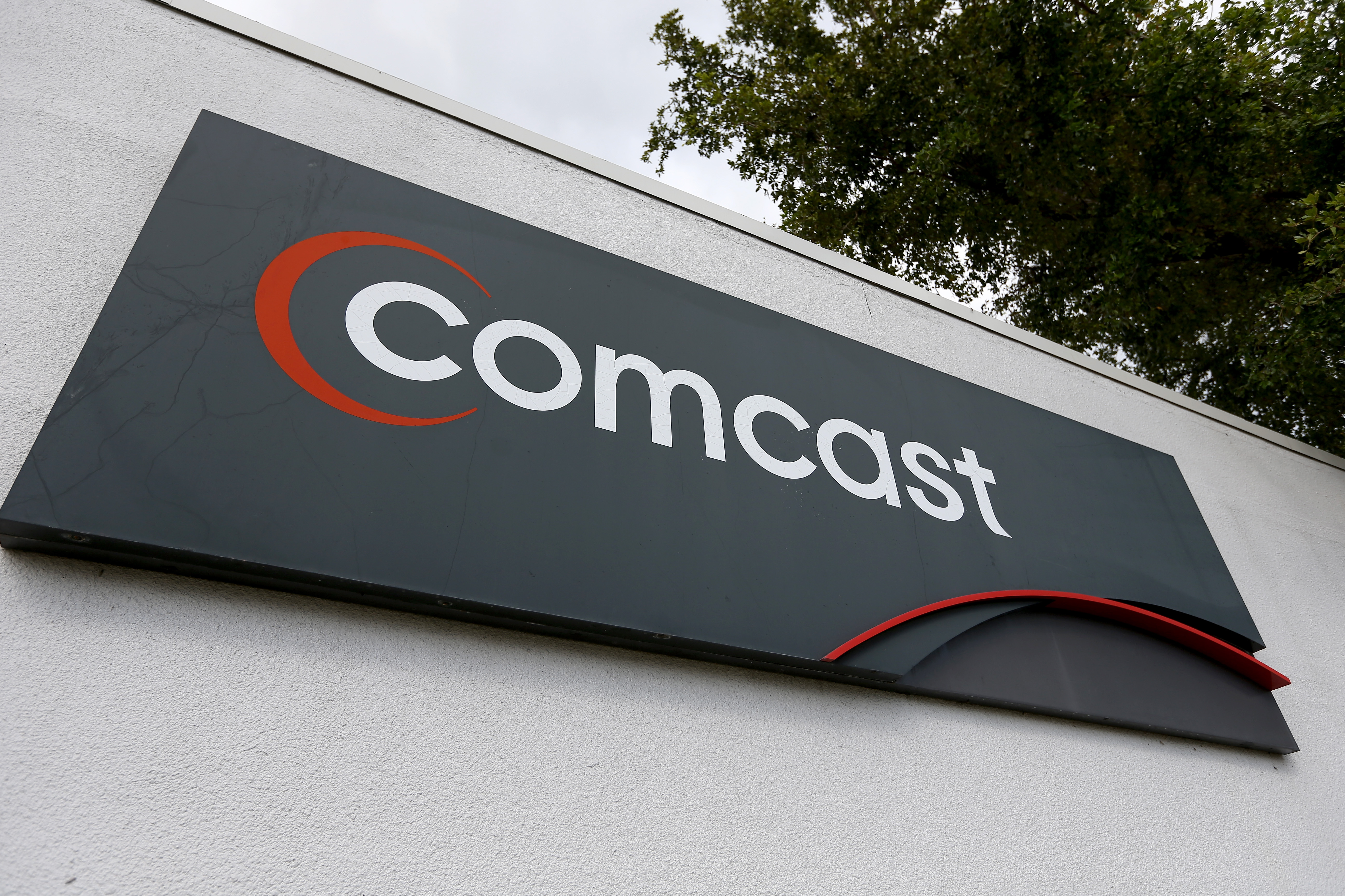 A Comcast sign is seen at one of their centers on February 13, 2014 in Pompano Beach, Florida.
