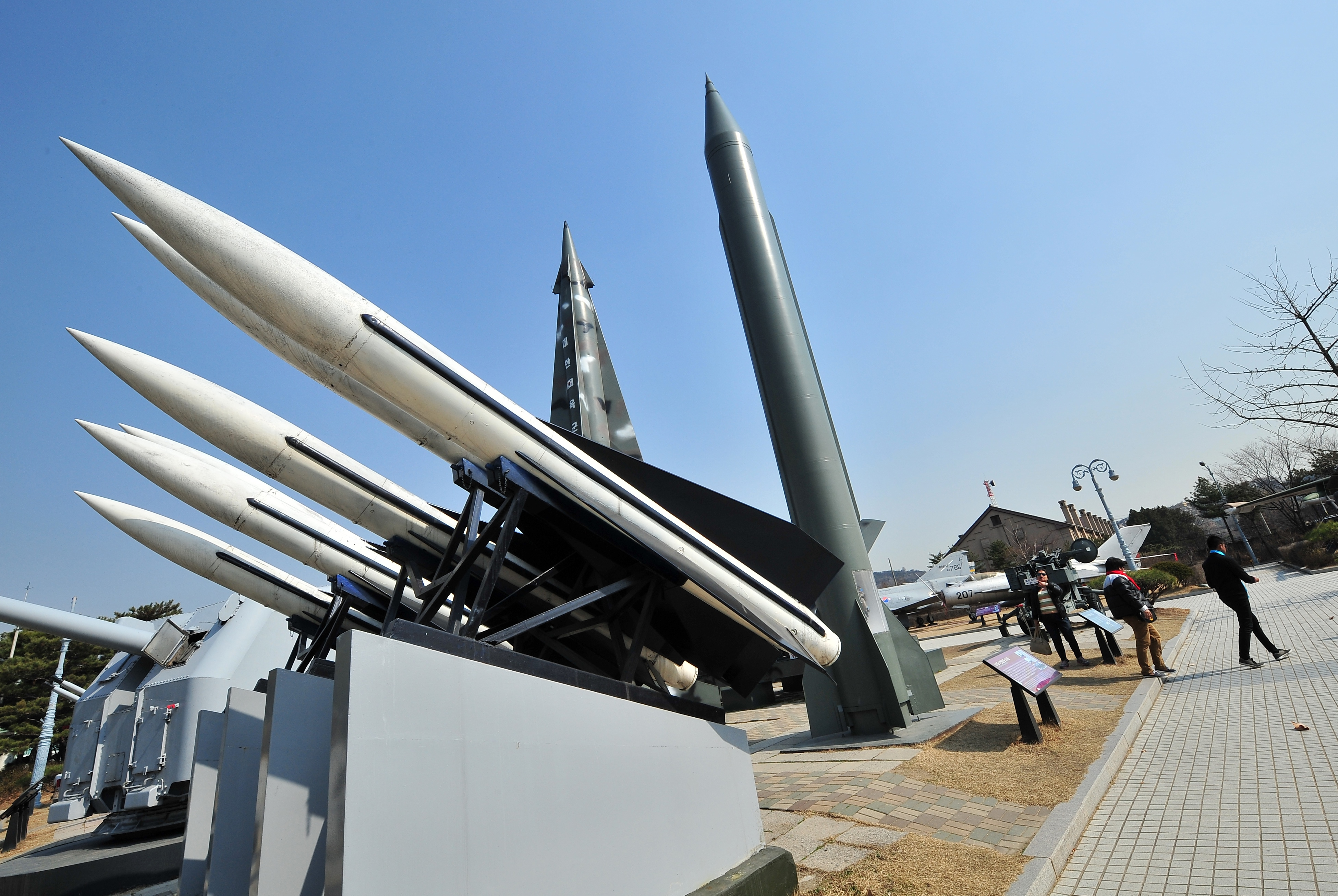 Visitors walk past replicas of a North Korean Scud-B missile, right, and South Korean Hawk surface-to-air missiles, left, at the Korean War Memorial in Seoul on March 3, 2014