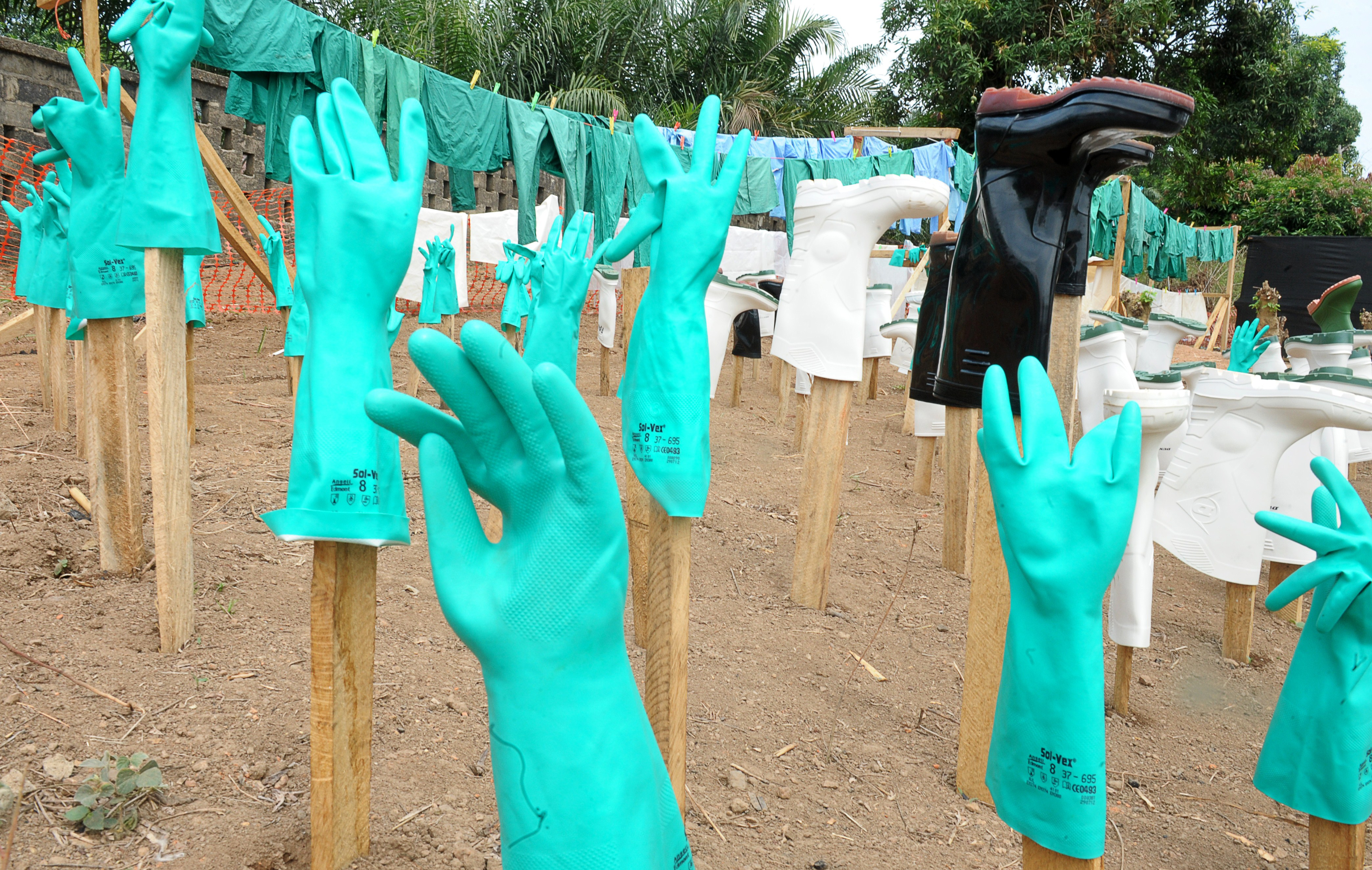Gloves and boots used by medical staff, drying in the sun, at a center for victims of the Ebola virus in Guéckédou, on April 1, 2014