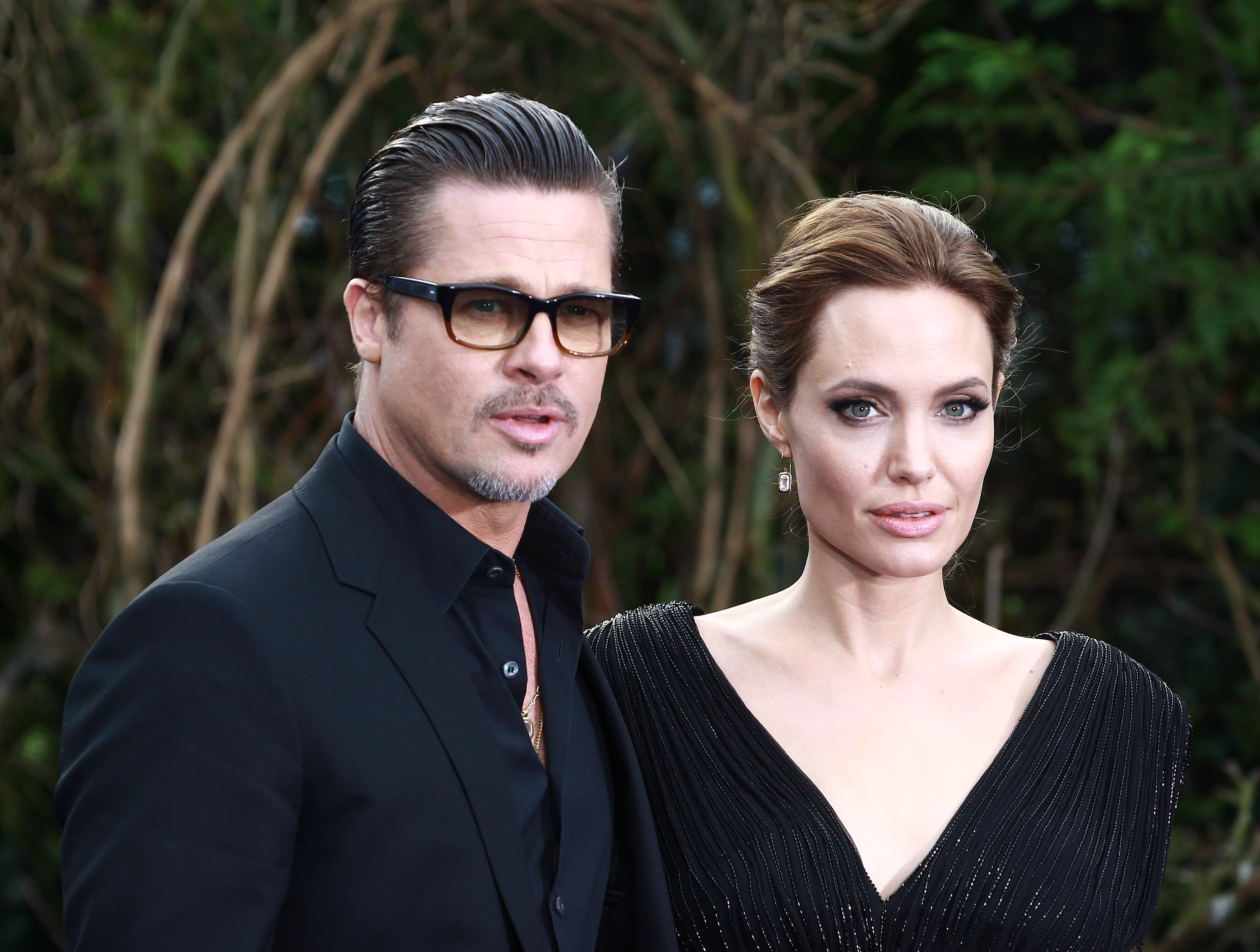 Brad Pitt and Angelina Jolie attends a private reception as costumes and props from Disney's  Maleficent  are exhibited in support of Great Ormond Street Hospital at Kensington Palace on May 8, 2014 in London.