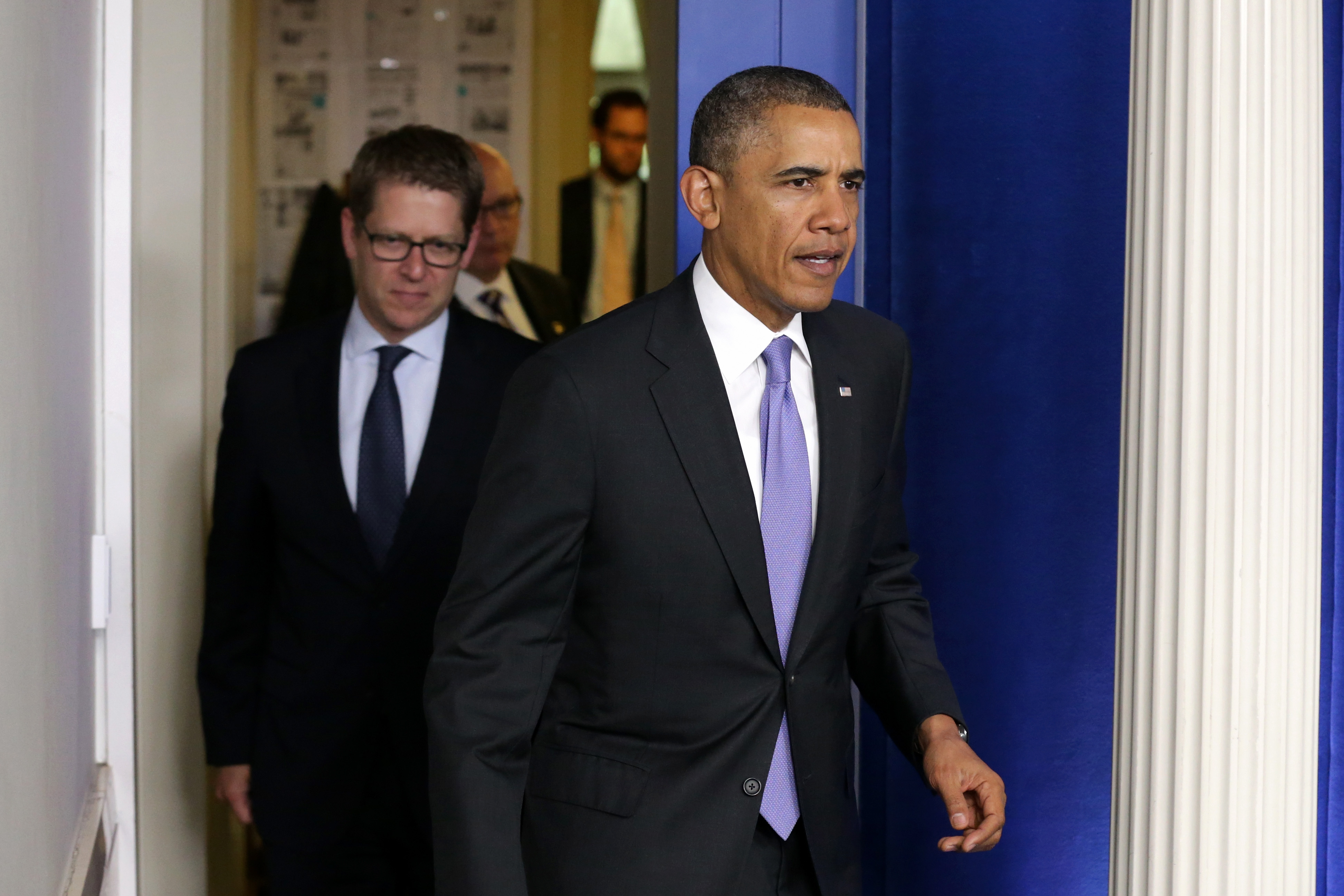 U.S. President Barack Obama (R) arrives to make a statement to the news media about the recent problems at the Veterans Affairs Department with White House Press Secretary Jay Carney in the Brady Press Briefing Room at the White House May 21, 2014 in Washington, DC.