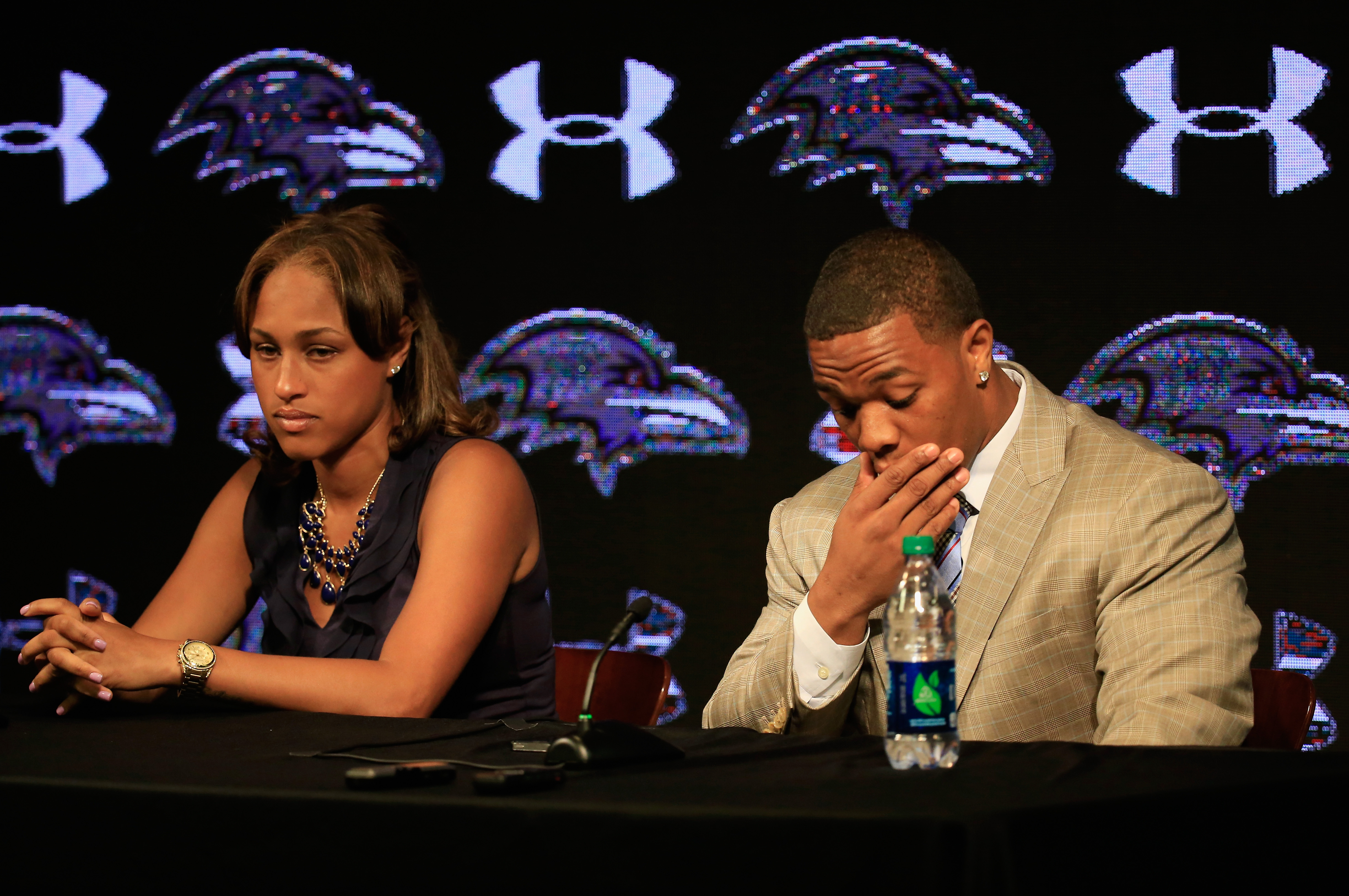 Running back Ray Rice of the Baltimore Ravens pauses while addressing a news conference with his wife Janay at the Ravens training center on May 23, 2014 in Owings Mills, Maryland.