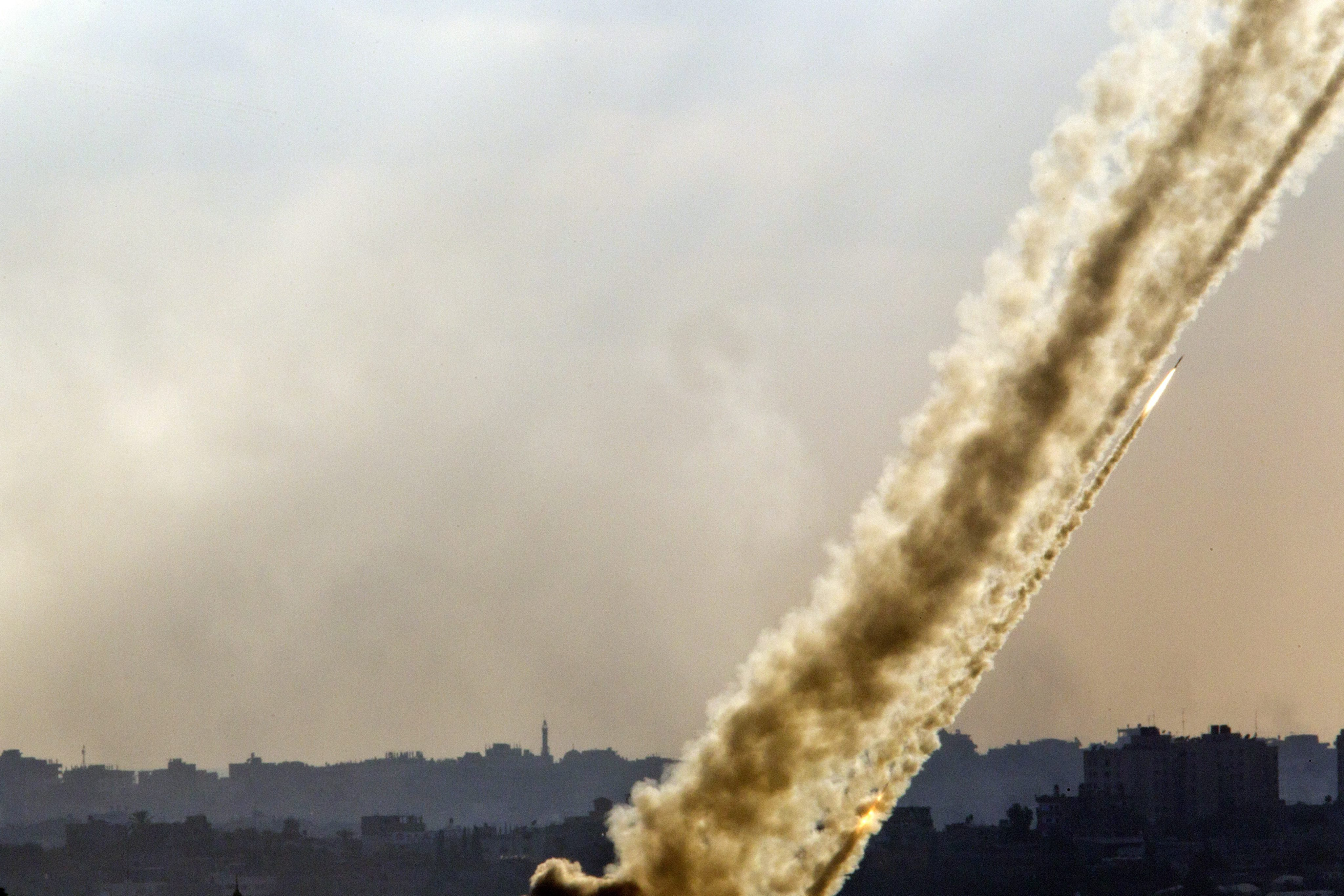 Multiple rocket launches from a site inside the Gaza Strip firing towards Israel are seen from a lookout point in southern Israel on July 17, 2014.
