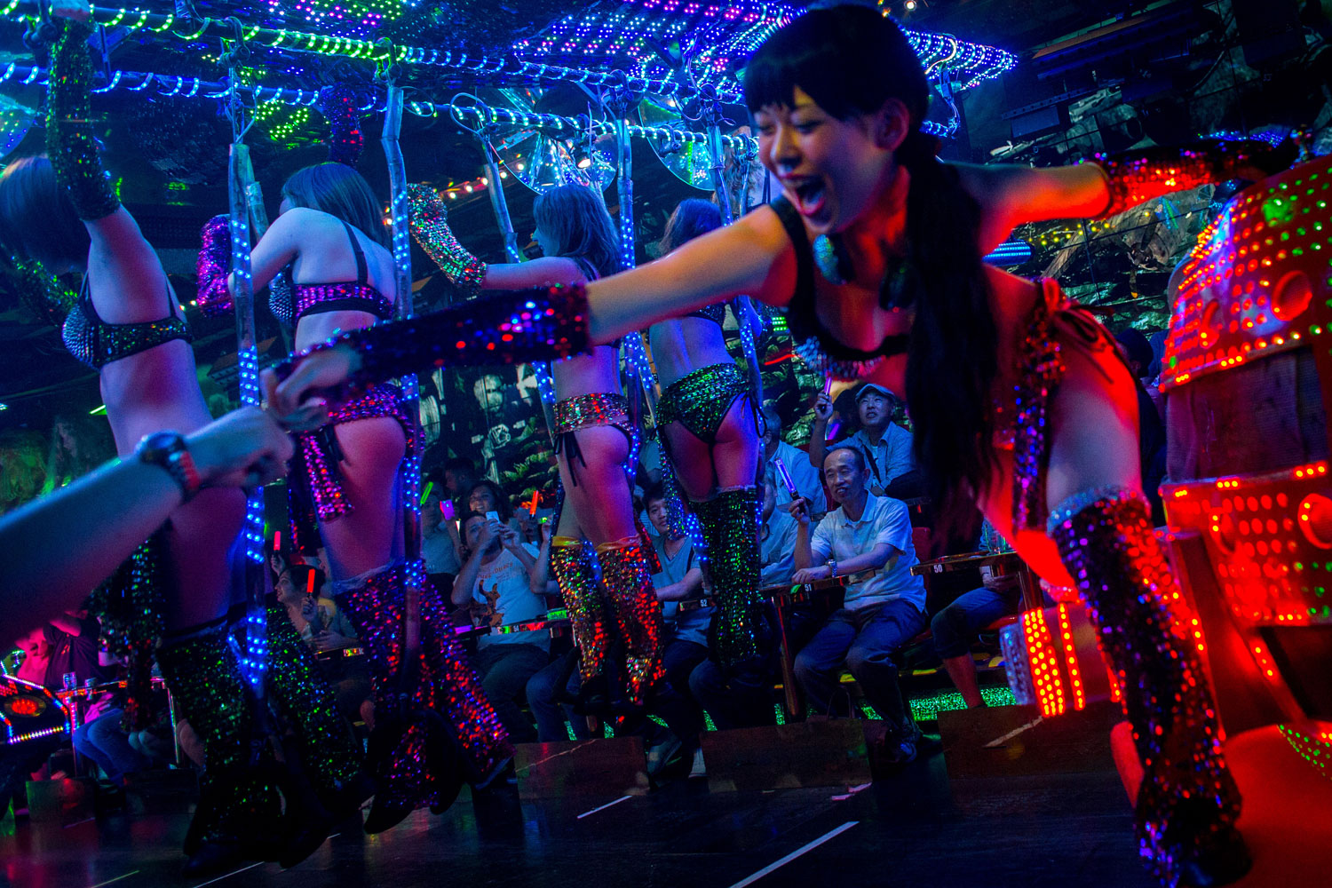 Dancers dressed as futuristic characters perform during a show at The Robot Restaurant on June 29, 2014 in Tokyo.
