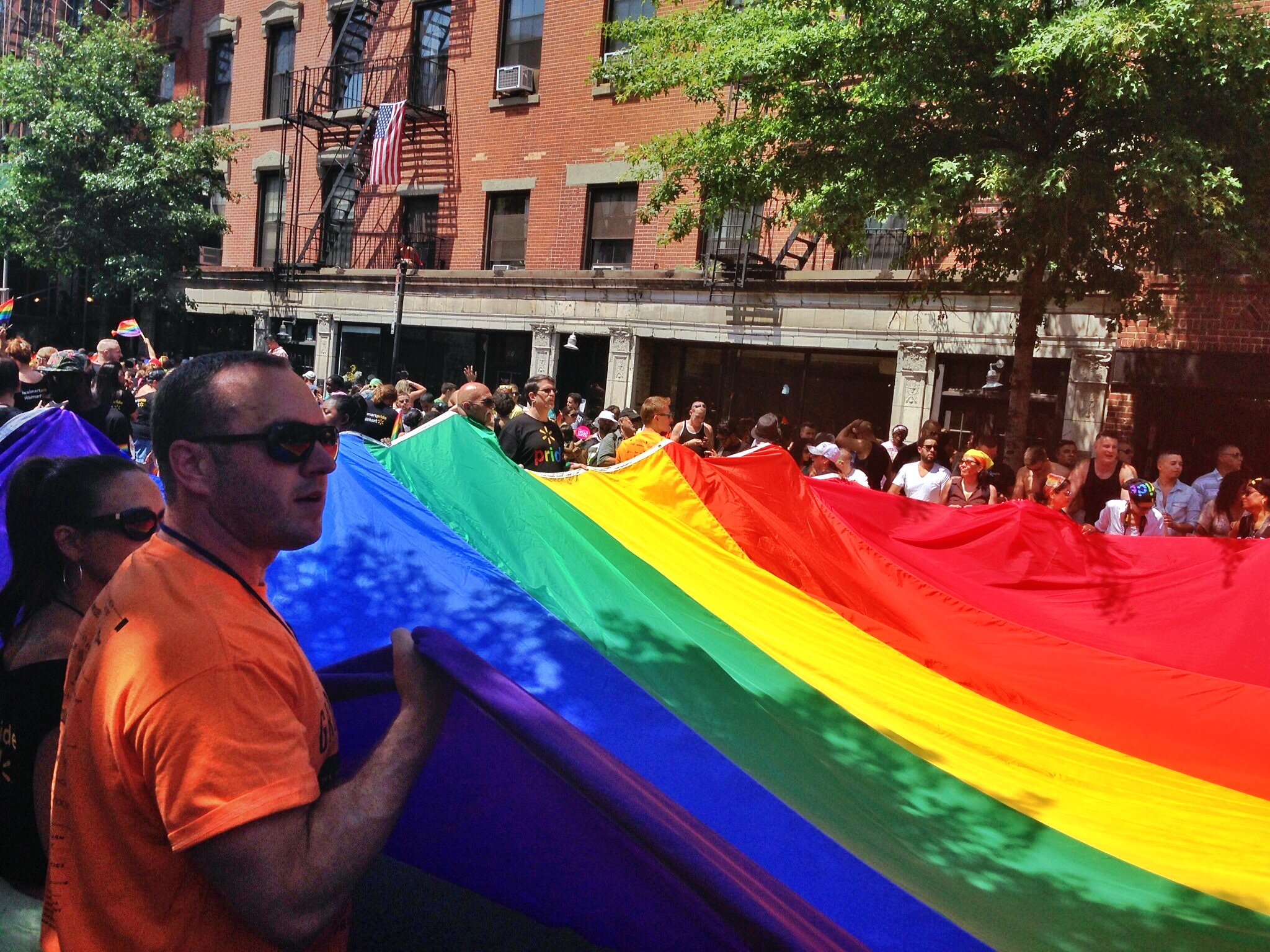 People carrying a giant rainbow flag in New York City's Pride Parade