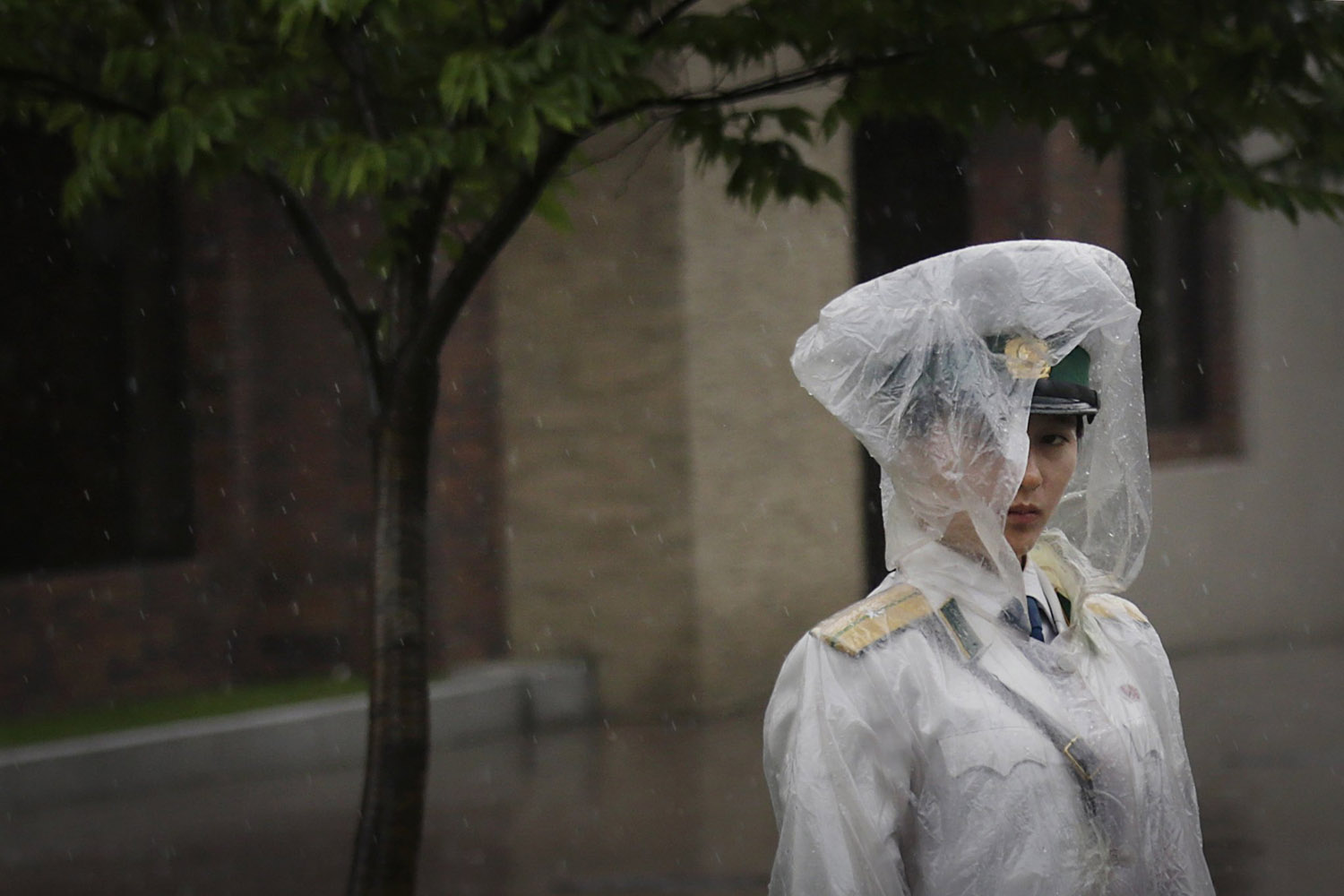 Jul. 25, 2014. A traffic controller stands in her rain gear in Pyongyang, North Korea. A typhoon was approaching North Korea on Friday as the country entered its rainy season.