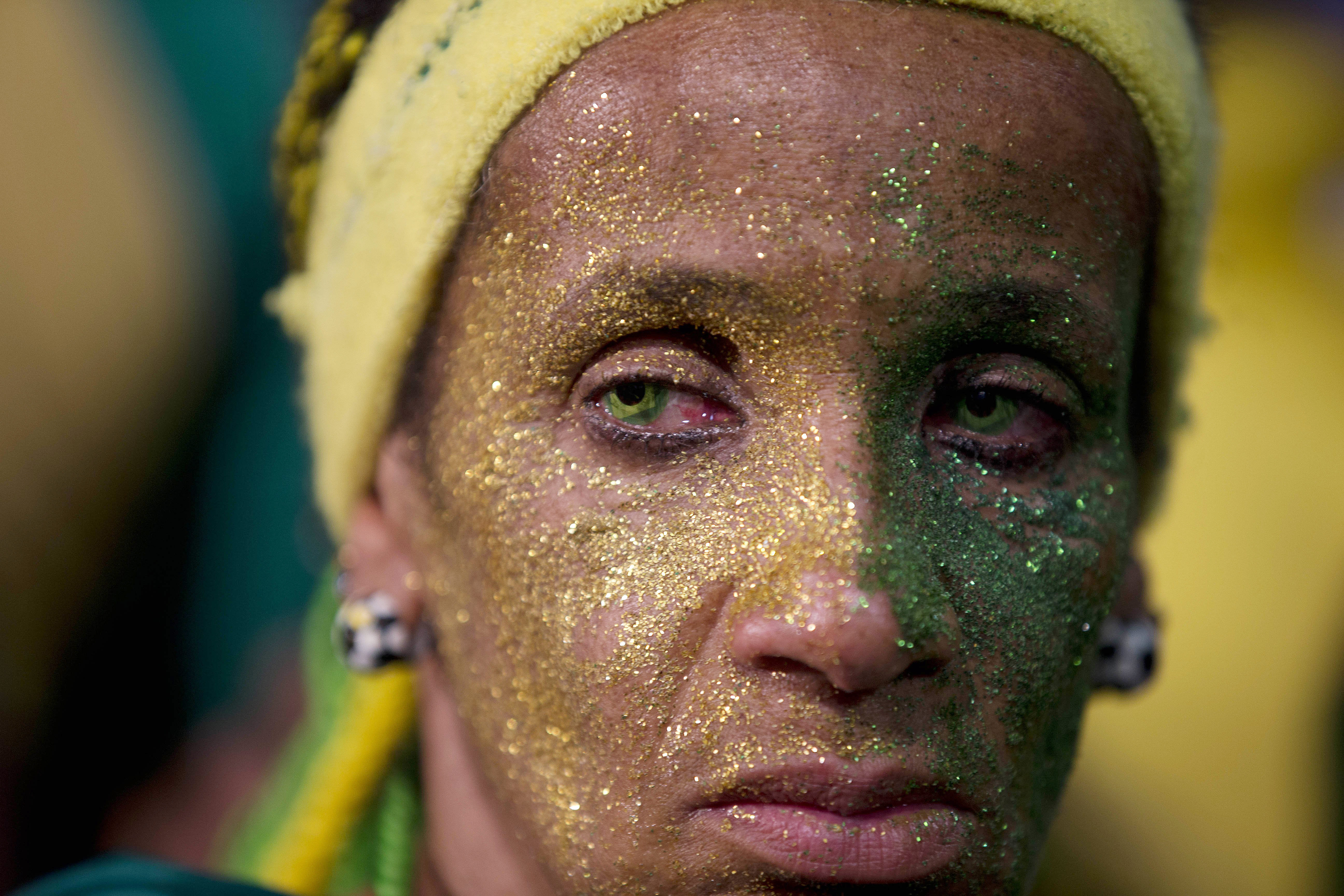A fan of the Brazilian national soccer team looks on as her team loses to Germany in a semi-final match in Sao Paulo, Brazil on July 8, 2014.