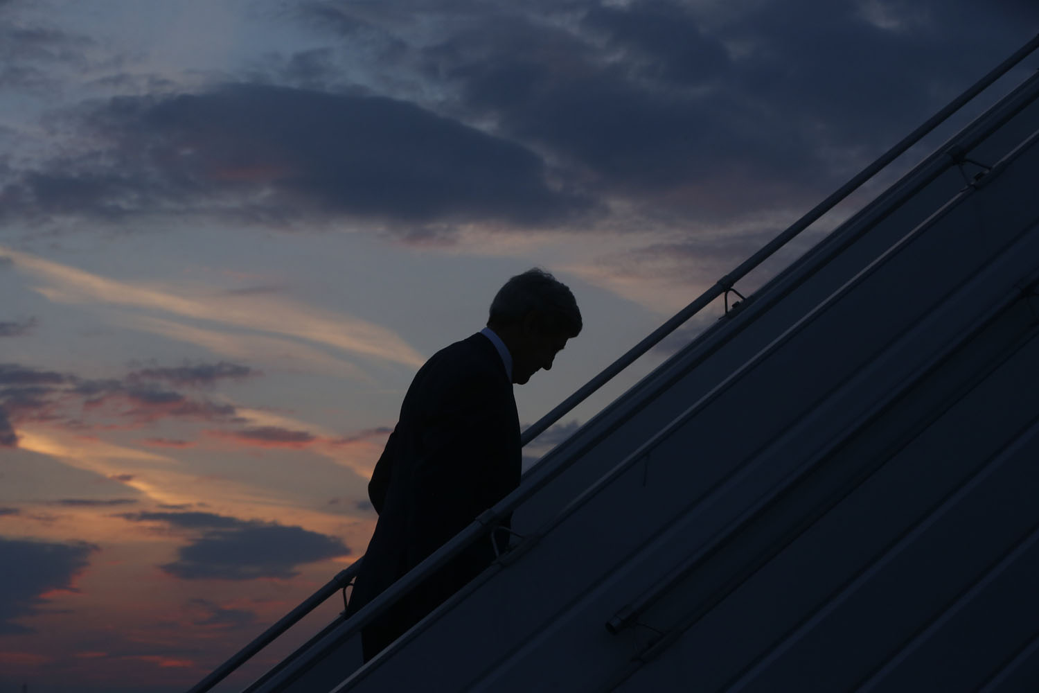 Jul. 26, 2014. U.S. Secretary of State John Kerry boards his plane in Paris, as he returns to Washington, following efforts to reach a longer truce between Israel and Hamas in Gaza.
