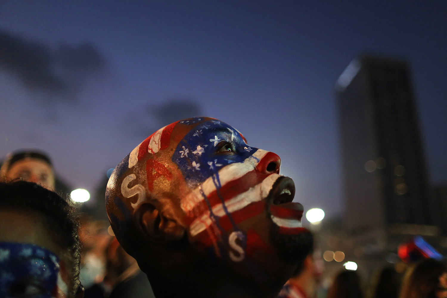 Jul. 1, 2014. A U.S. soccer fan watches his team's World Cup round of 16 match against Belgium on a live telecast inside the FIFA Fan Fest area on Copacabana beach in Rio de Janeiro, Brazil.