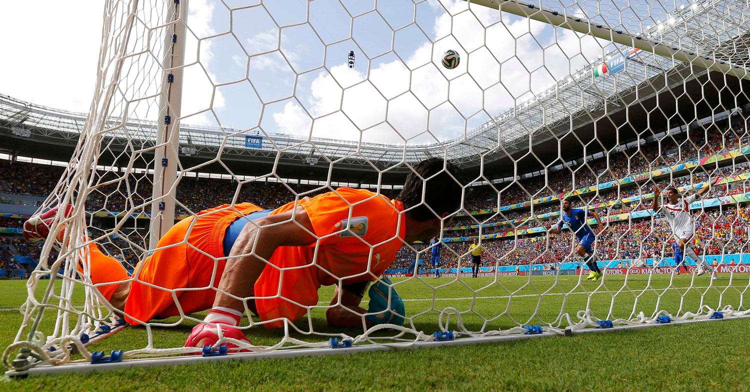 Italy's goalkeeper Gianluigi Buffon lies in the net after conceding a goal scored by Costa Rica's Bryan Ruiz during their match at the Pernambuco arena in Recife, Brazil on June 20, 2014.