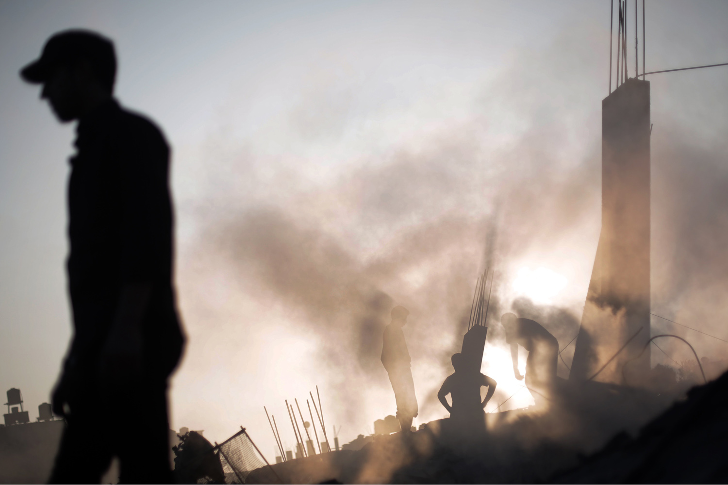 Jul. 8, 2014. Palestinians search through the rubble of a house destroyed by an overnight Israeli airstrike in Gaza City.