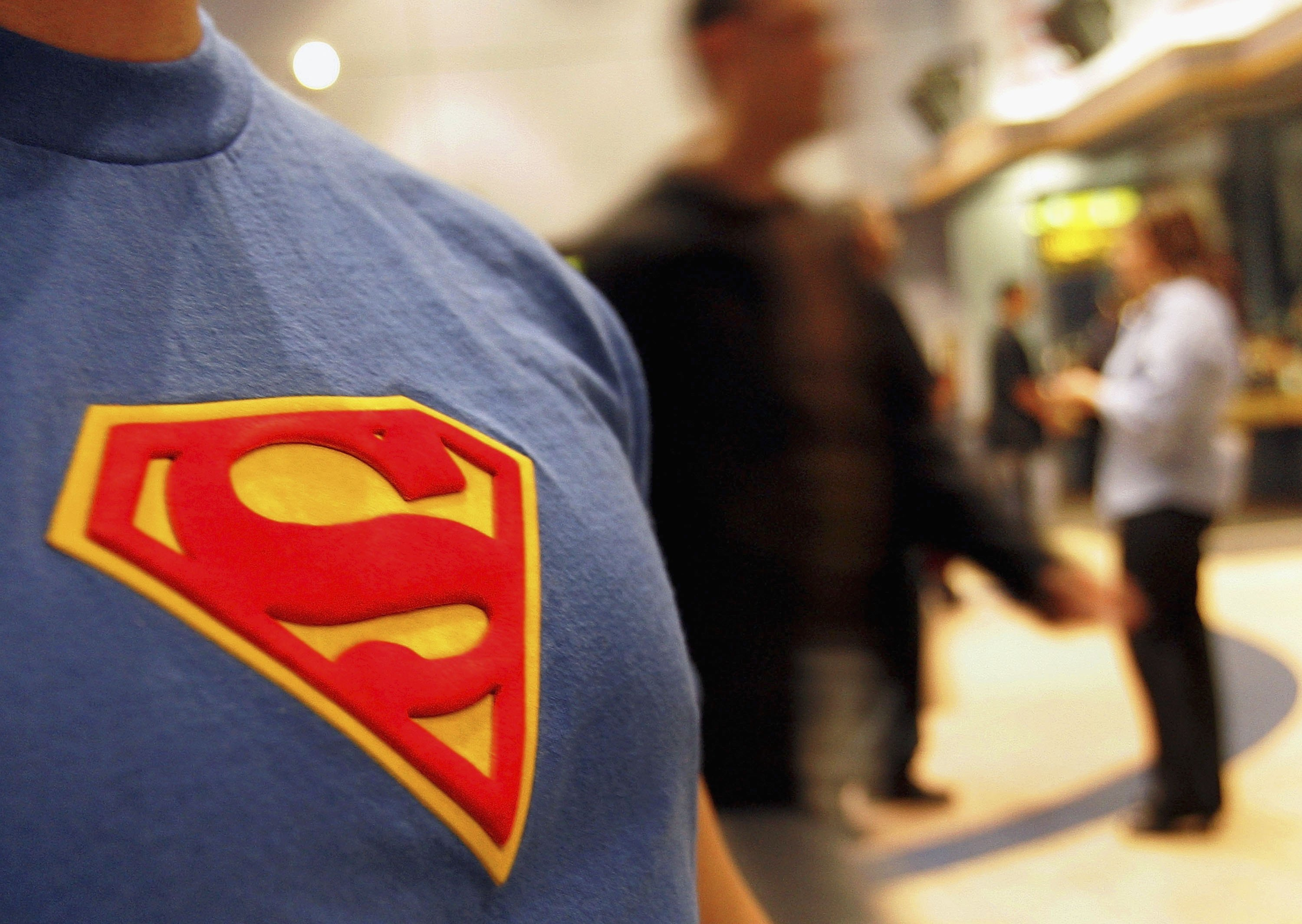 CHICAGO - JUNE 27: A moviegoer wearing his Superman tee-shirt is seen in the lobby prior to watching the new Superman Returns movie on June 27, 2006 in Chicago, Illinois. The theater had a special showing of the much anticipated new Superman movie at 10pm. (Photo by Tim Boyle/Getty Images)