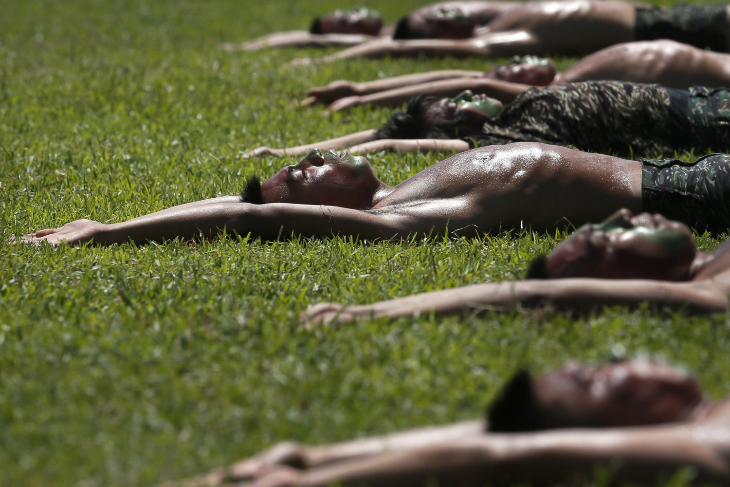 Jul. 21, 2014. Taiwan Marine Corps  Frog Men  display stretching routines during a tour at the naval base in Zuoying, southern Taiwan.