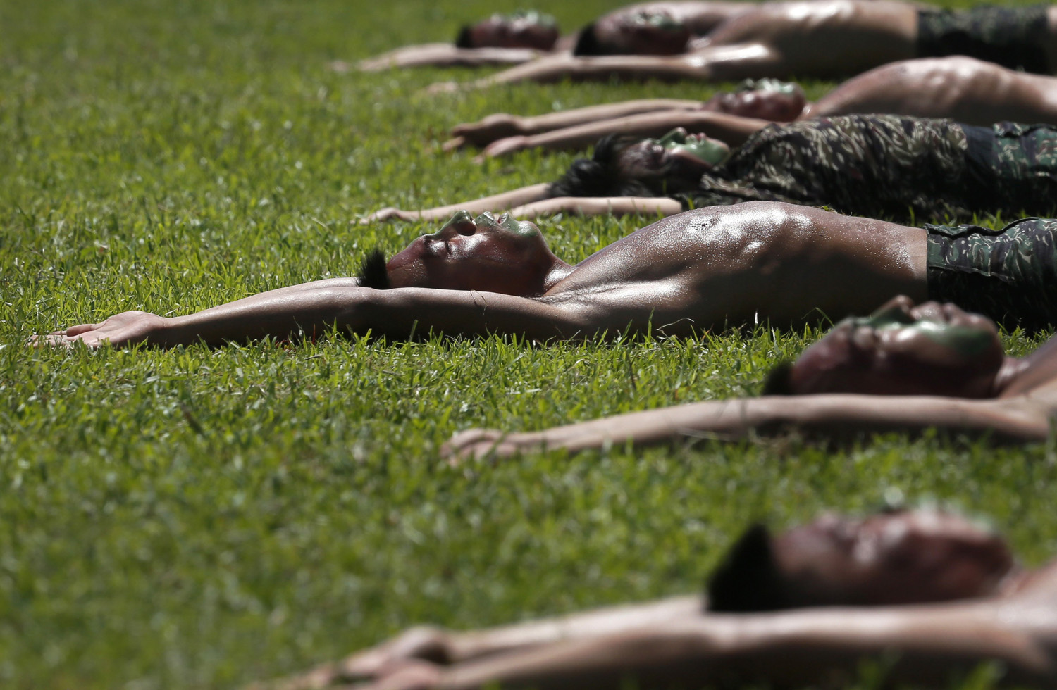 Taiwan Marine Corps  Frog Men  display stretching routines during a tour at the naval base in Zuoying, southern Taiwan on July 21, 2014.