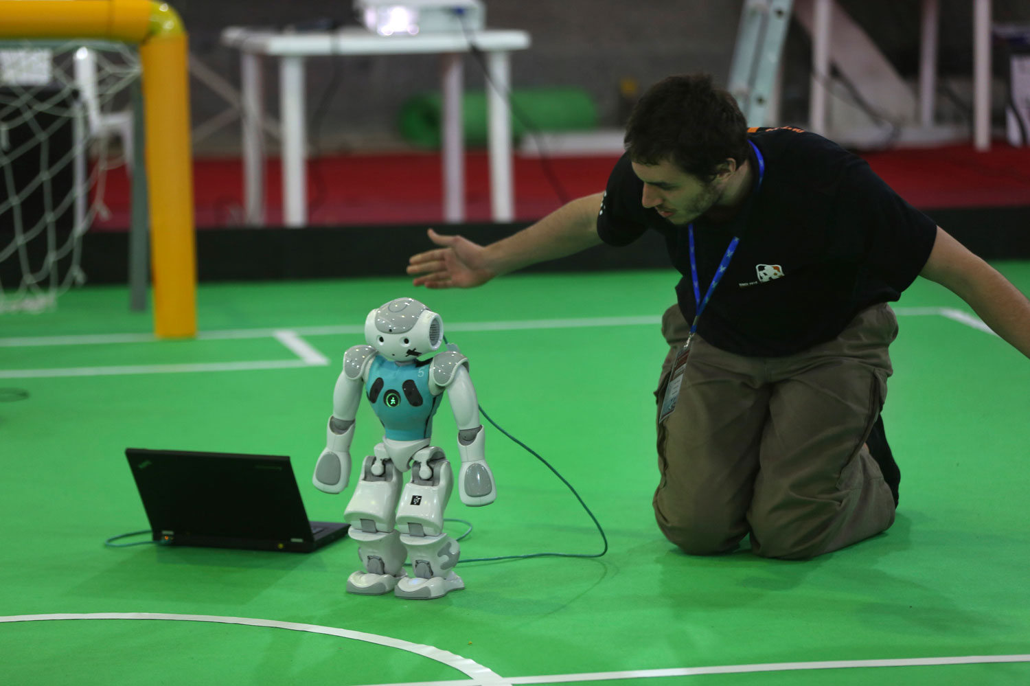 A participant from the Netherlands prepares his humanoid robot for a soccer match in the international robotics competition in Tehran, Iran on April 10, 2014.