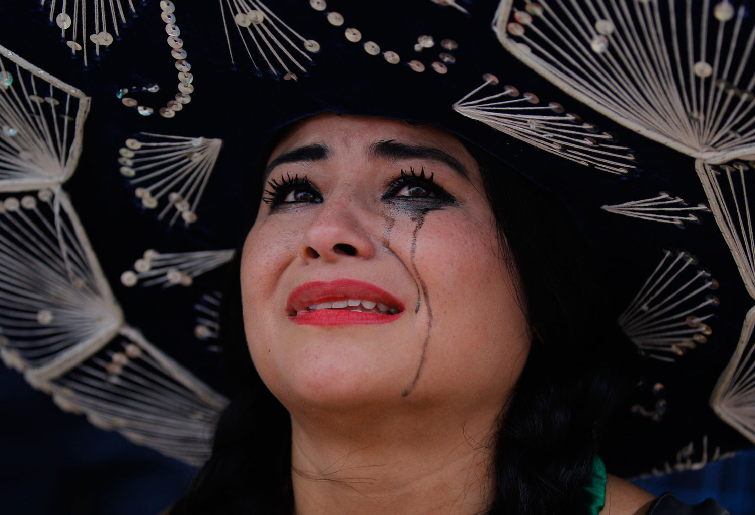 Netherlands vs. Mexico 2-1                                                              A Mexico soccer fan cries after her team was defeated, on Copacabana beach in Rio de Janeiro on June 29, 2014.