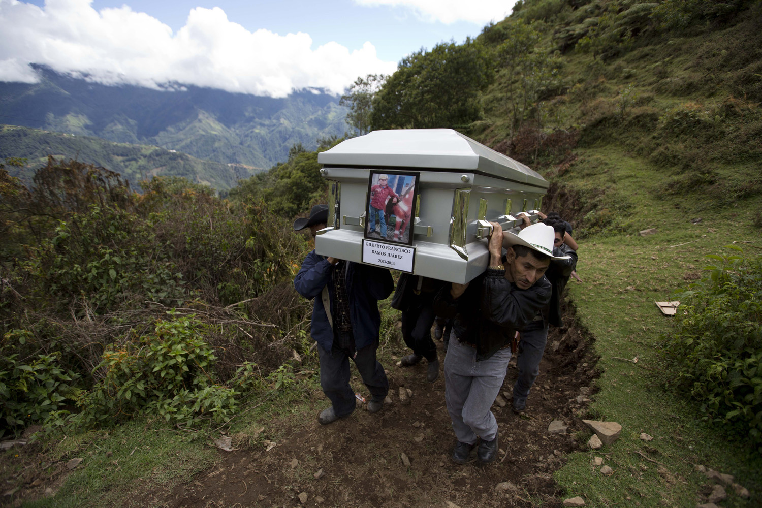 Jul. 12, 2014. Relatives carry to a local cemetery, the coffin containing the remains of Gilberto Francisco Ramos Juarez, a Guatemalan migrant boy whose decomposed body was found in the Rio Grande Valley of South Texas, in San Jose Las Flores, Guatemala.