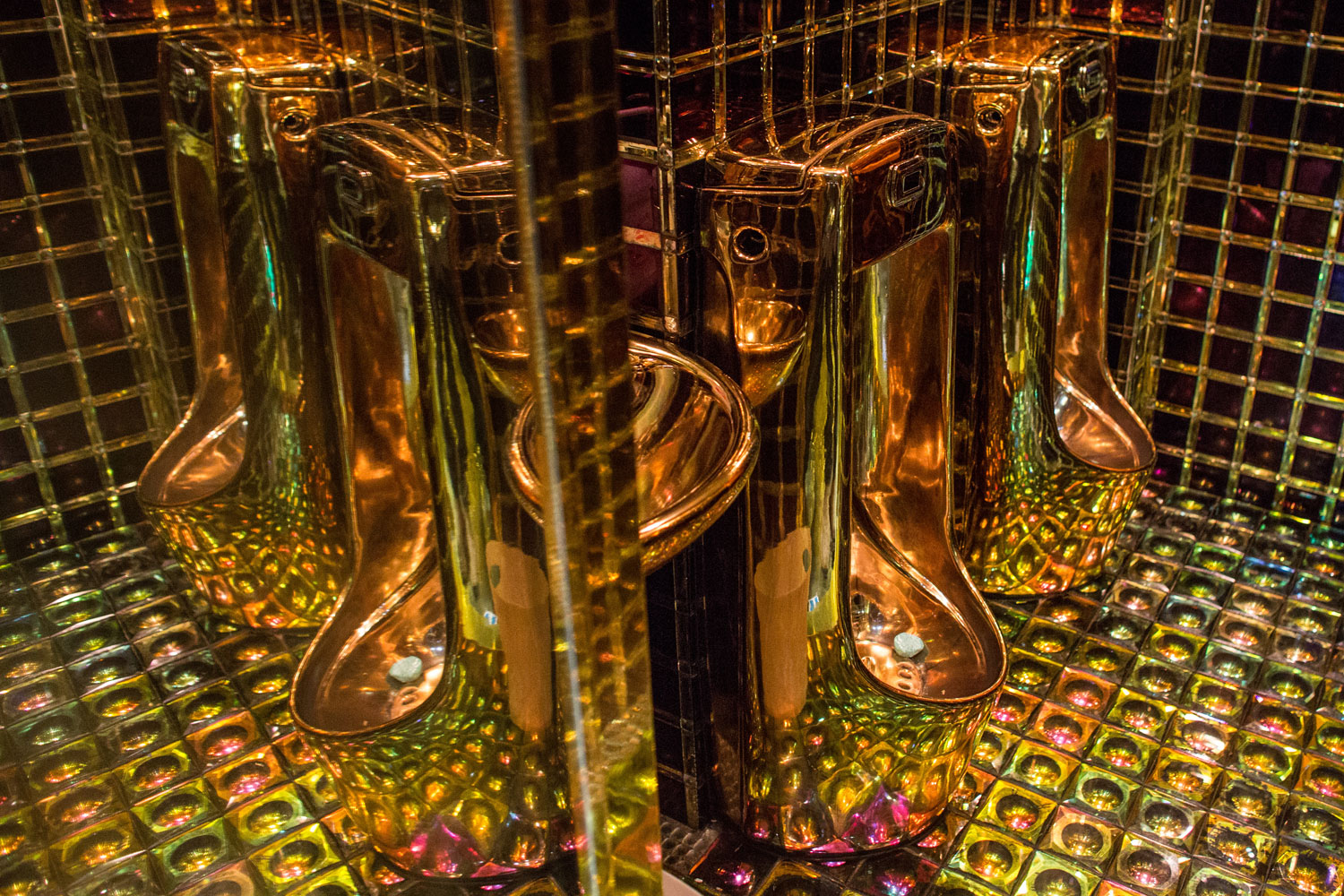 Gold colored urinals are seen in the men's bathroom  at The Robot Restaurant on June 29, 2014 in Tokyo.