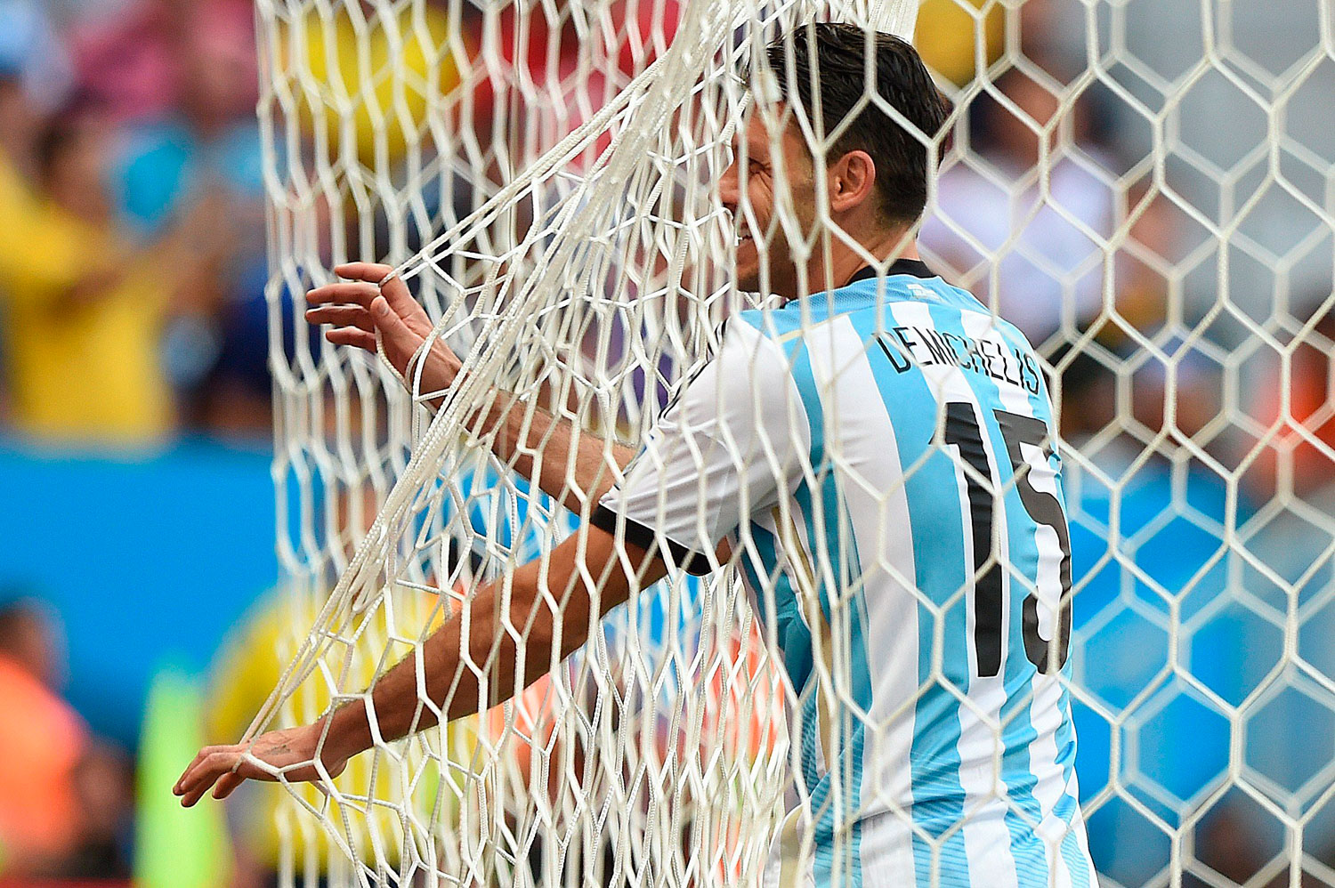Argentina's defender Martin Demichelis stands in the nets during a quarter-final football match between Argentina and Belgium at the Mane Garrincha National Stadium in Brasilia, Brazil  on July 5, 2014.