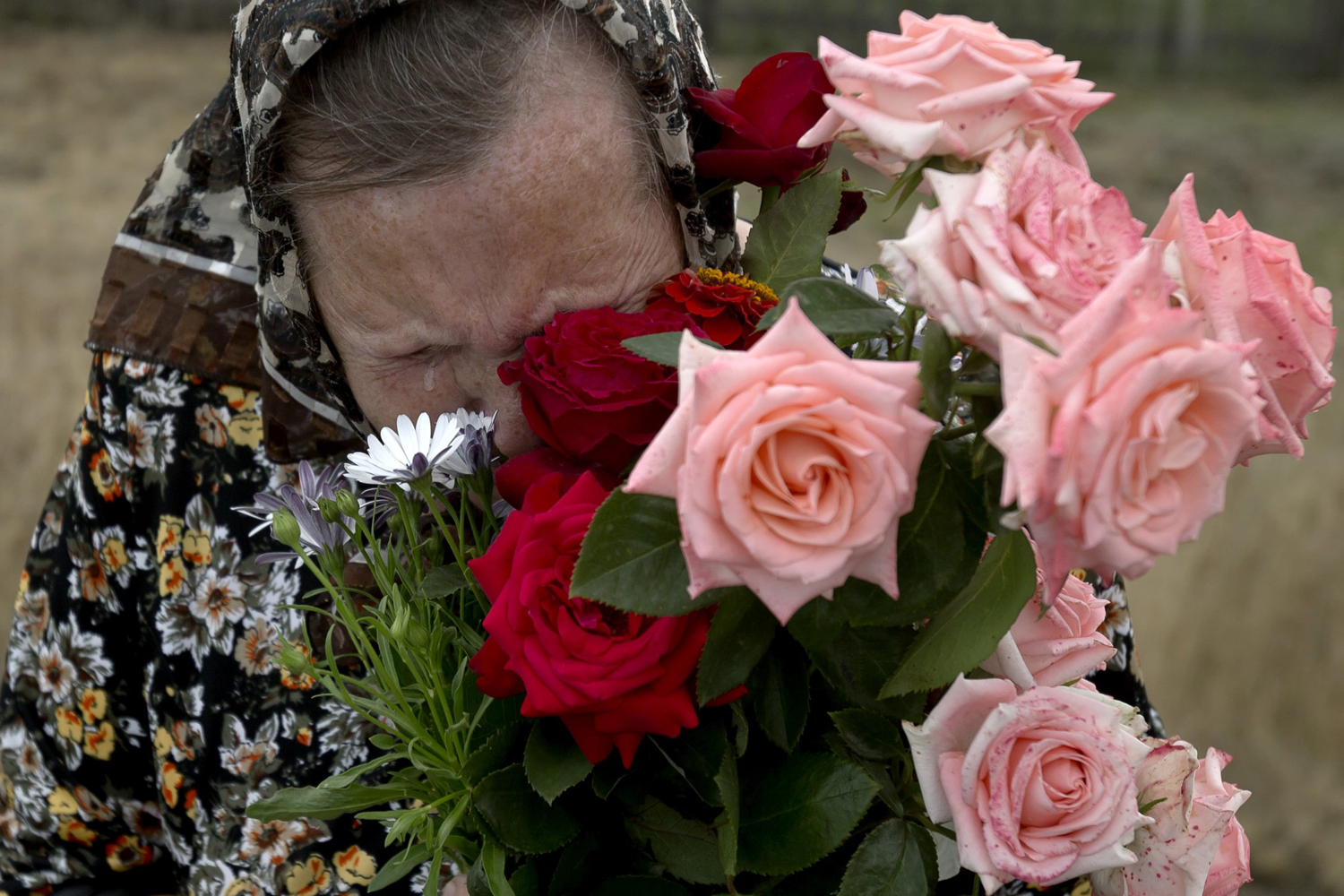 Jul. 22, 2014. A woman cries during a religious service held by villagers in memory of the victims at the crash site of Malaysia Airlines Flight 17 near the village of Hrabove, eastern Ukraine.