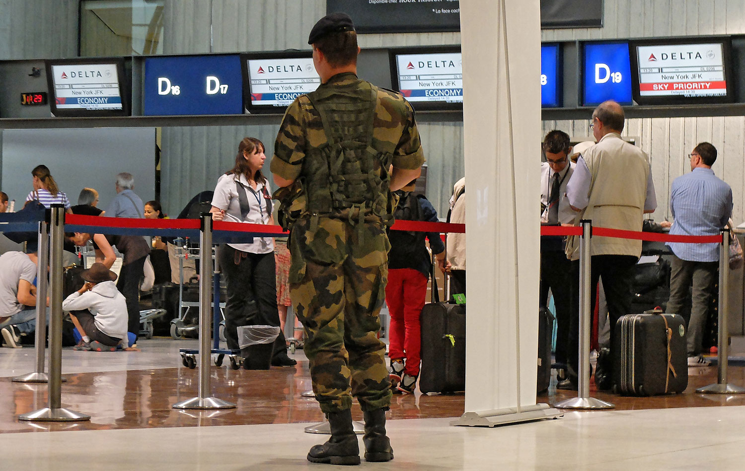 A French soldier stands in front of the desk of American airline company 'Delta Air Lines' in Nice airport, south eastern France, July 4, 2014.