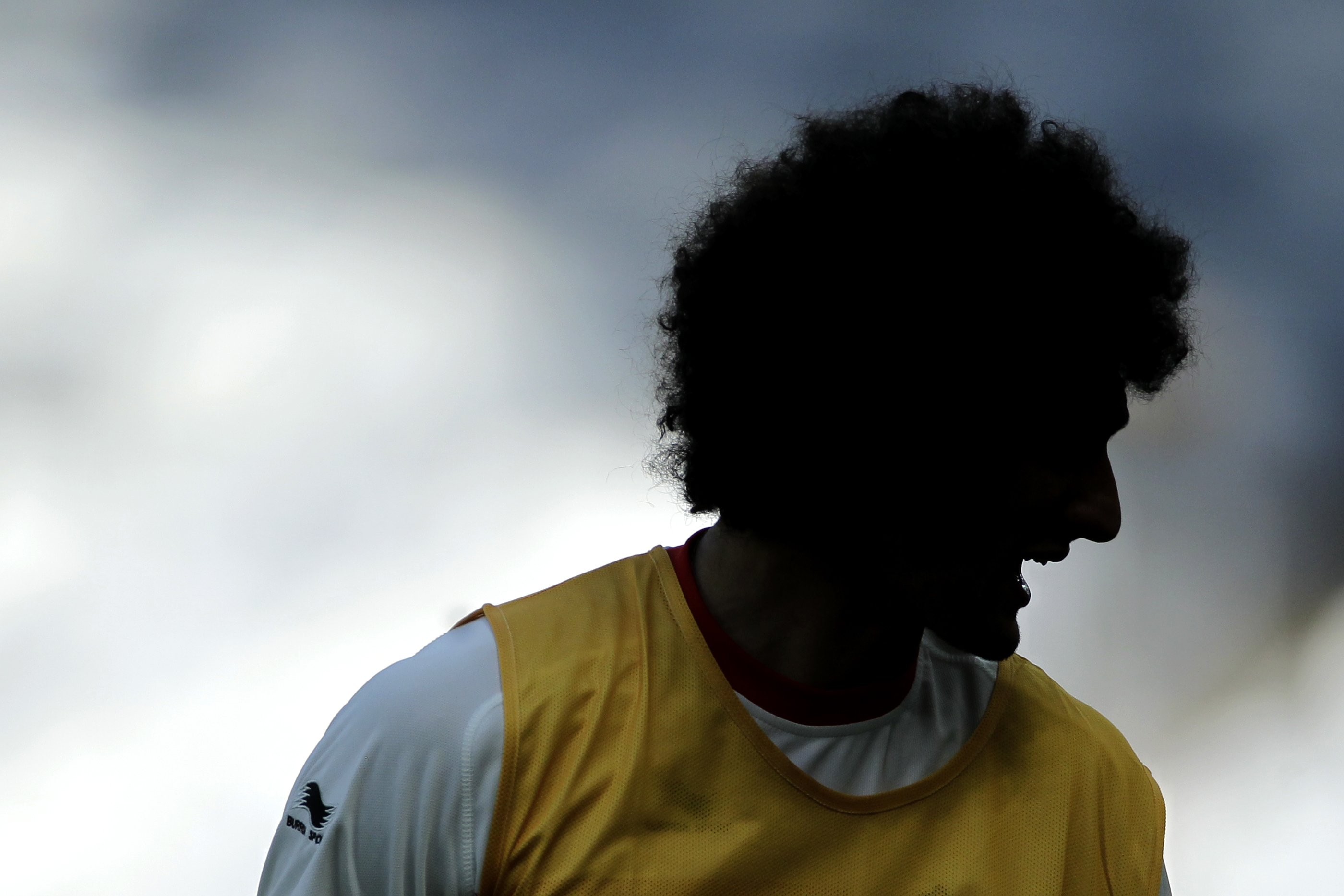 Belgiumís Marouane Fellaini laughs during a training session at the Mineirao Stadium in Belo Horizonte, Brazil on June 16, 2014.