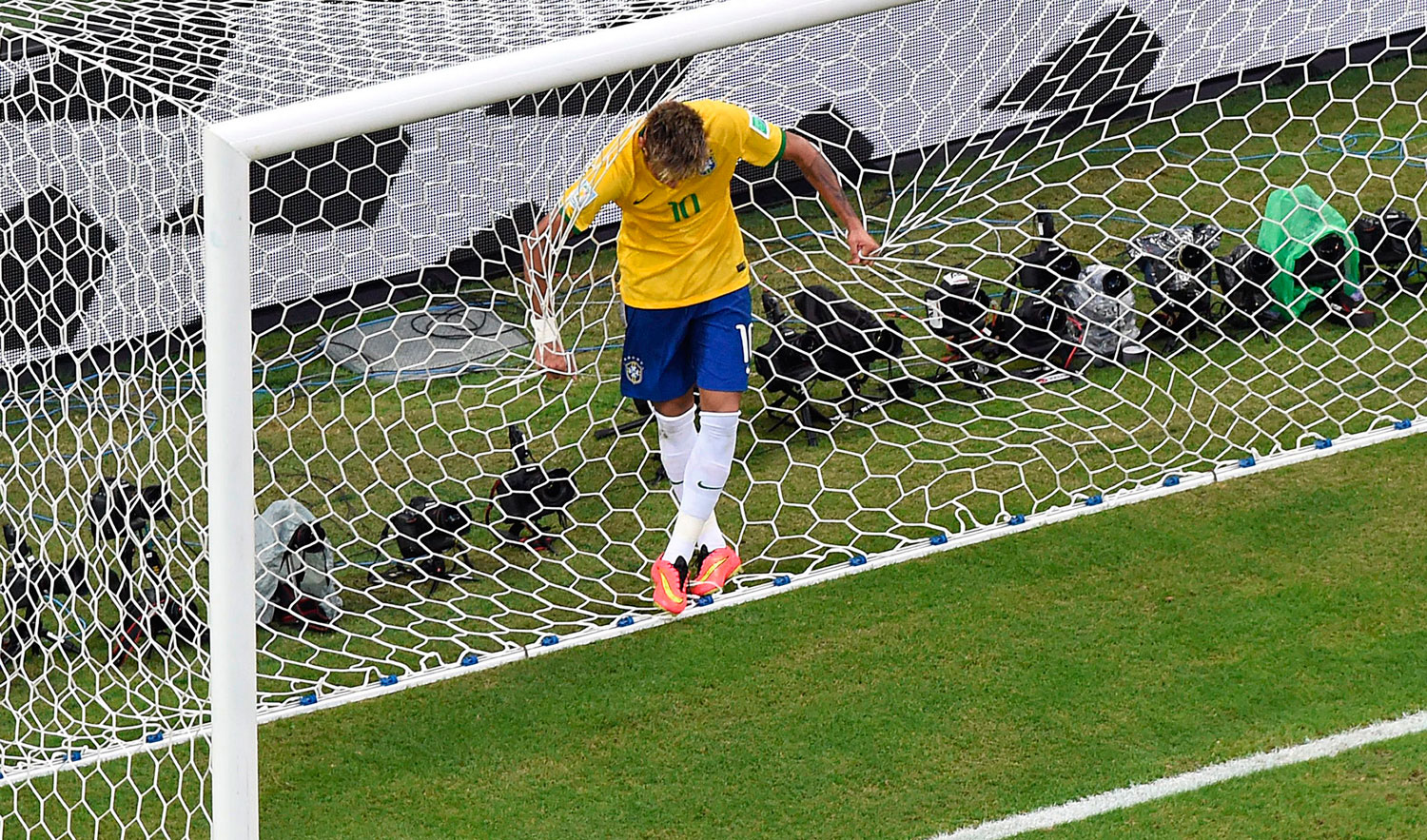 Brazil's forward Neymar reacts after missing a goal opportunity during a match between Brazil and Mexico in the Castelao Stadium in Fortaleza, Brazil on June 17, 2014.