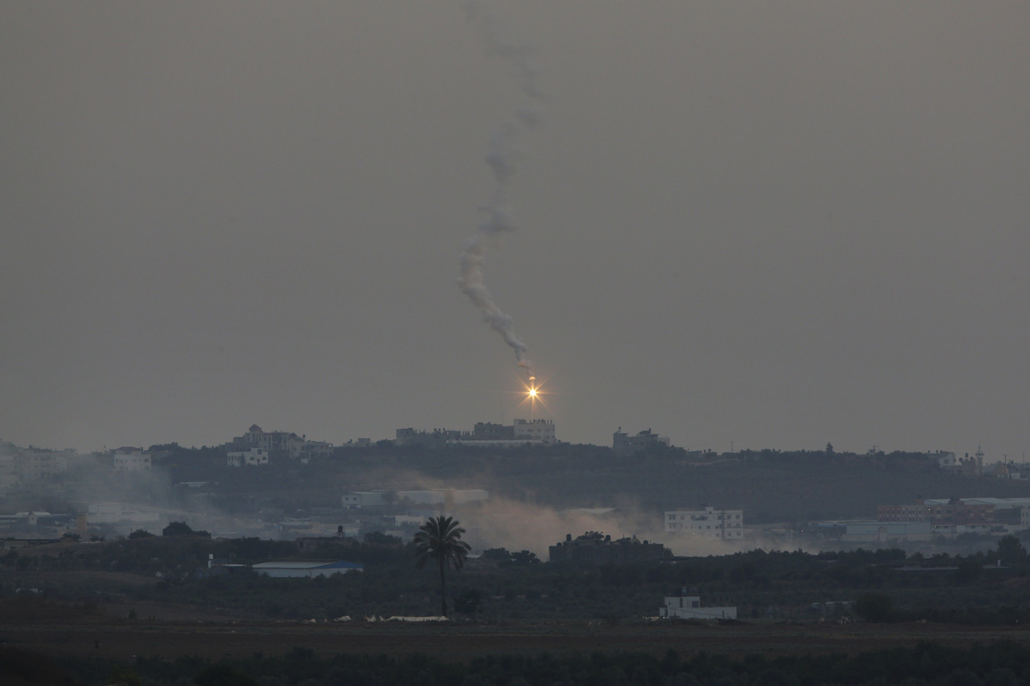 Jul. 12, 2014. A flare launched by Palestinians militants falls over Gaza, as seen from the Israel-Gaza border.