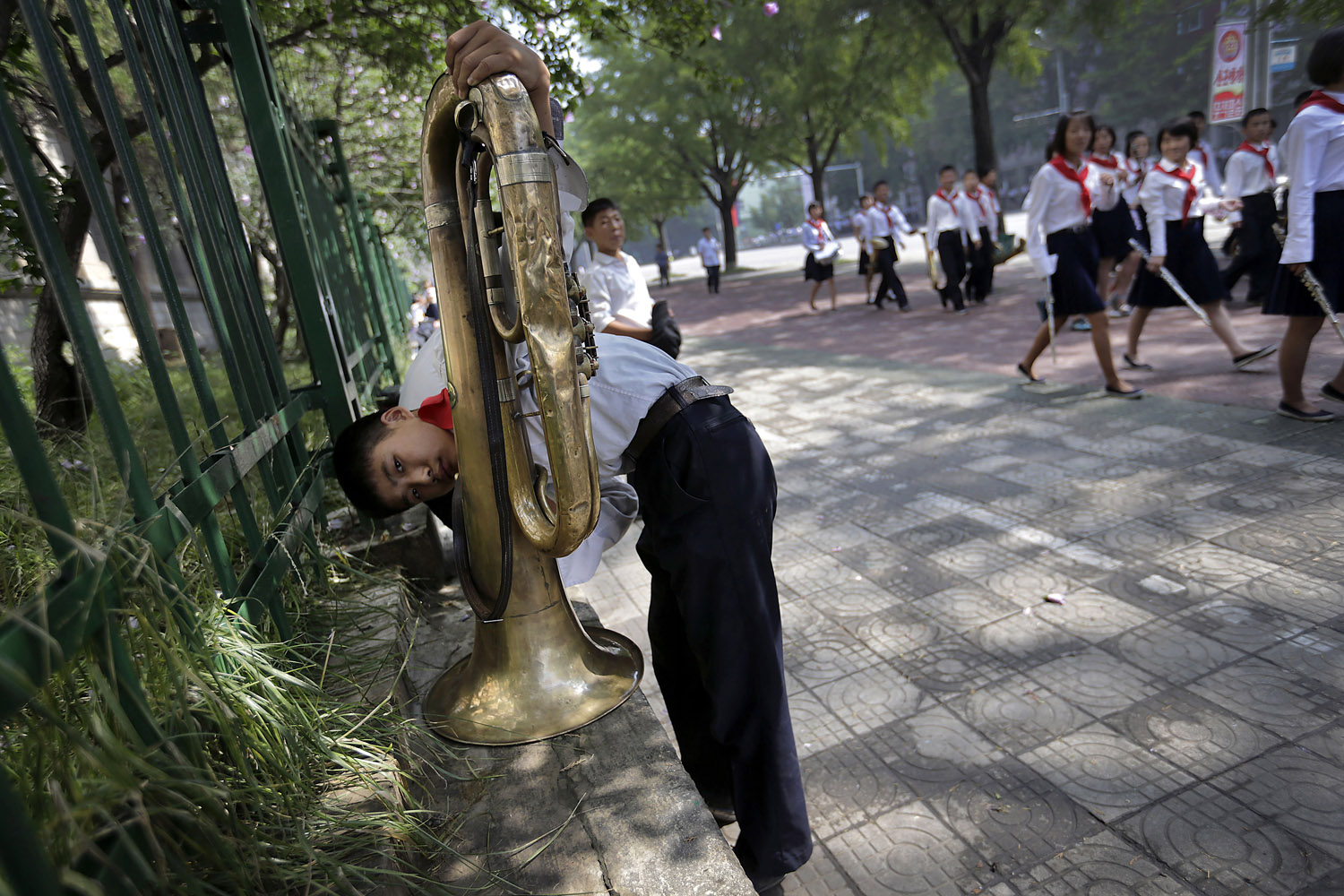 Jul. 27, 2014. A North Korean student cleans his tuba ahead of a parade to celebrate the anniversary of the Korean war armistice agreement  in Pyongyang, North Korea.