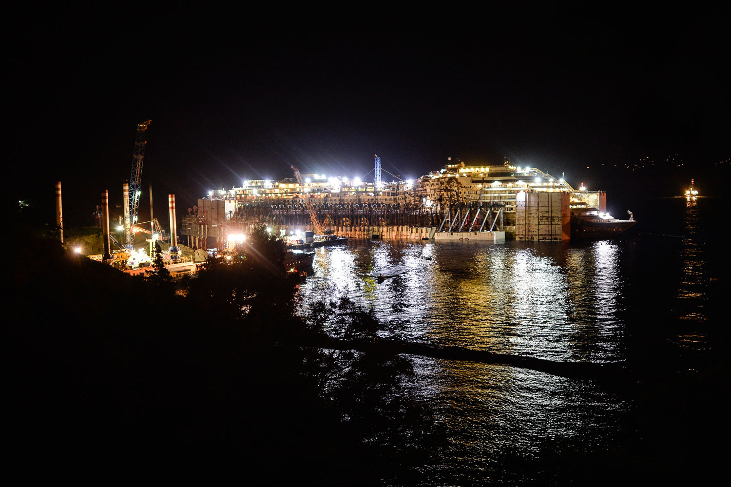 Costa Concordia in front of the harbour of Isola del Giglio, after it was refloated using air tanks attached to its sides, on July 23, 2014 off Giglio Island, Italy.