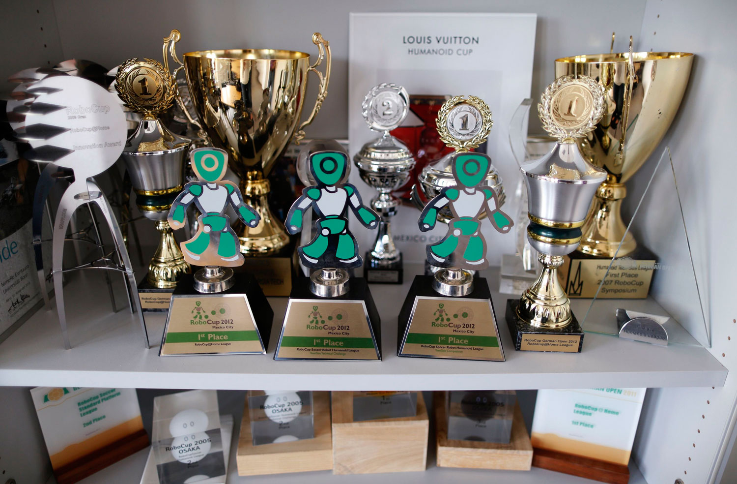 Trophies won by humanoid robots at competitions are seen during a photo opportunity at the Institute for Computer Science at the University of Bonn in Bonn, Germany on July 3, 2014.