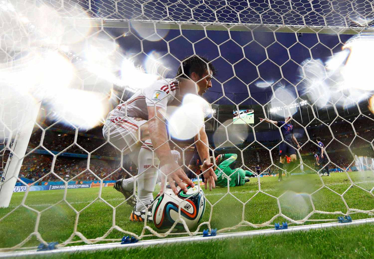 Spain's David Silva picks the ball out of the net after his goal against the Netherlands was disallowed during their match at the Fonte Nova arena in Salvador, Brazil on June 13, 2014.