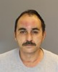 Ali Al-Asadi was arrested for burning a Quran outside the Karabala Islamic Center in Dearborn, Mich. on June 25, 2014.