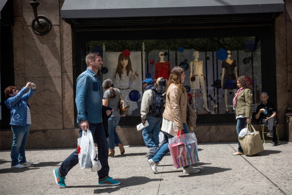 Shoppers walk through Herald Square, outside a New York City Macy's in May.