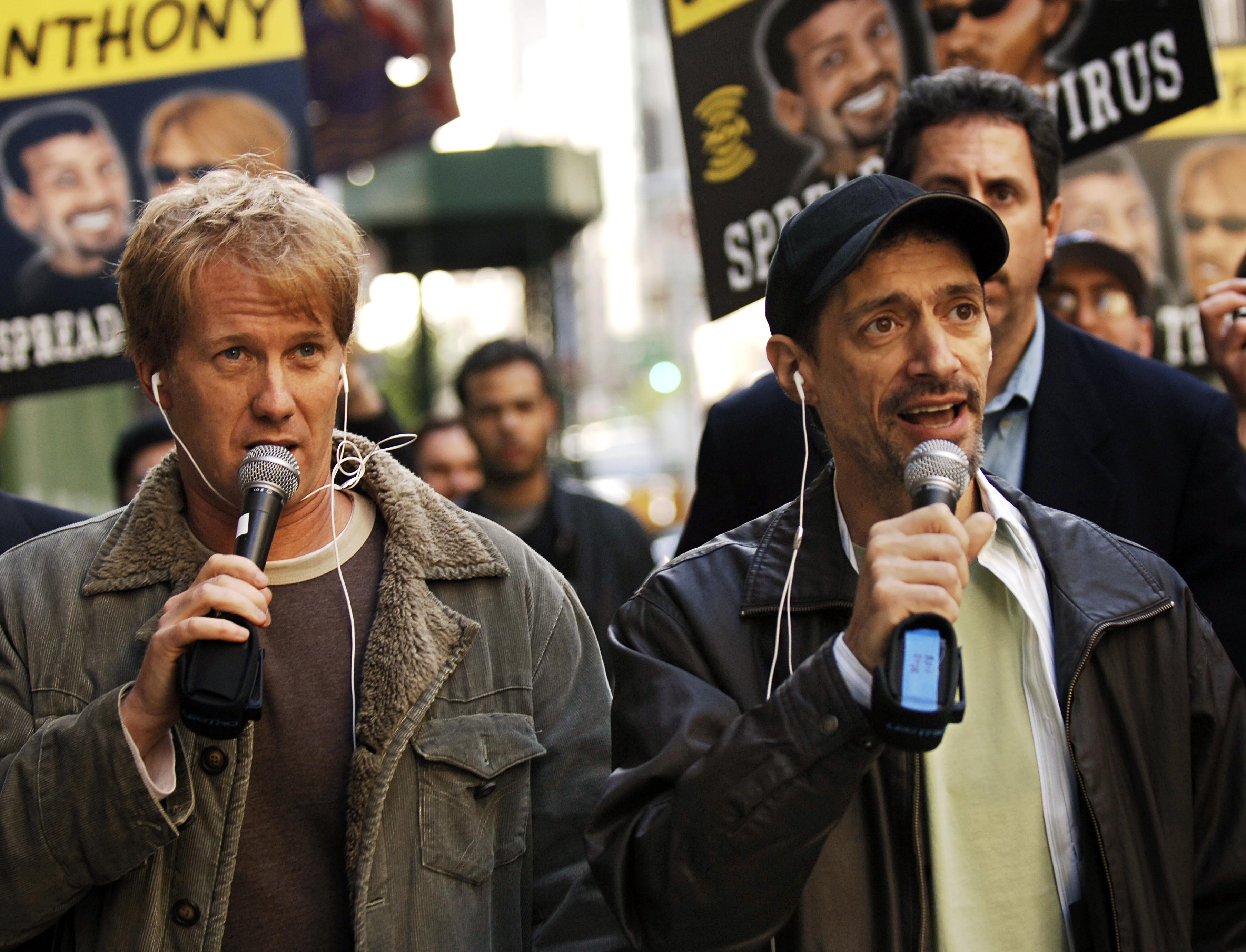 Radio shock jocks Greg  Opie  Hughes, left, and Anthony Cumia, right, leave CBS Radio studios on 57th Street with fans after finishing their first morning show, in New York.  Cumia of the  Opie & Anthony  radio show on  April 26, 2006.
