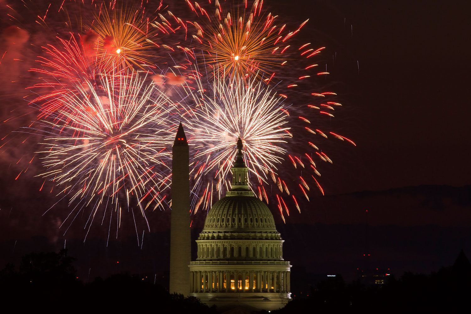 Fireworks illuminate the sky over the U.S. Capitol building and the Washington Monument during Fourth of July celebrations, on Friday, July 4, 2014, in Washington.