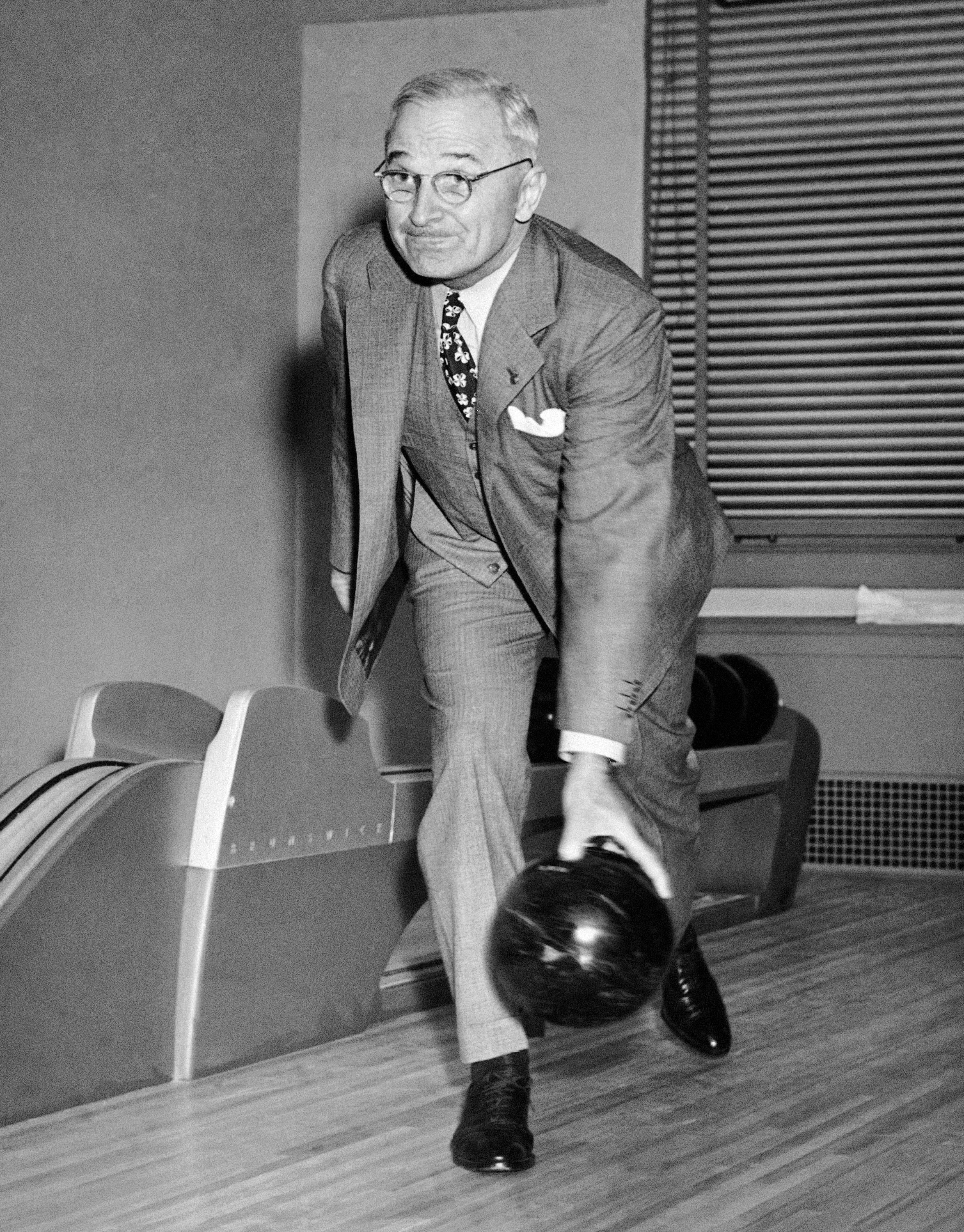 President Harry S. Truman rolls one down the alley at the formal opening of the White House bowling alley on April 19, 1947 in Washington.