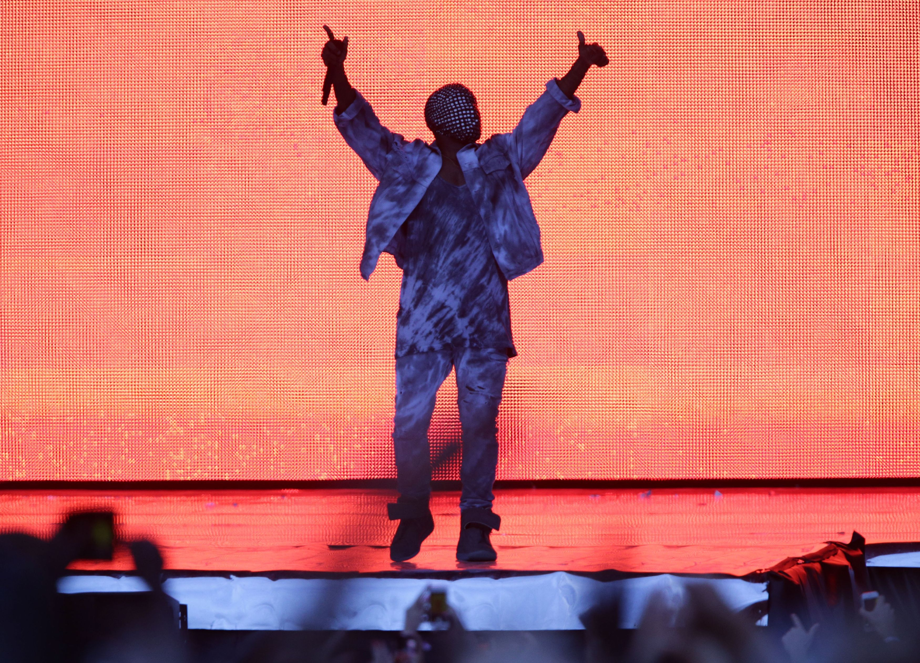 Kanye West performing at the Wireless Festival.