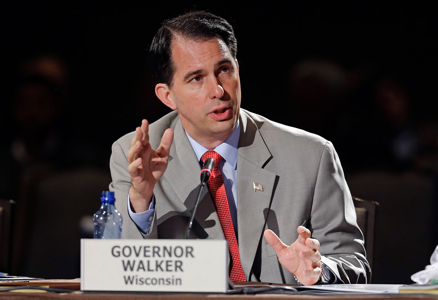 Wisconsin Governor Scott Walker speaks during a meeting on jobs and education at the National Governors Association convention, July 12, 2014, in Nashville.