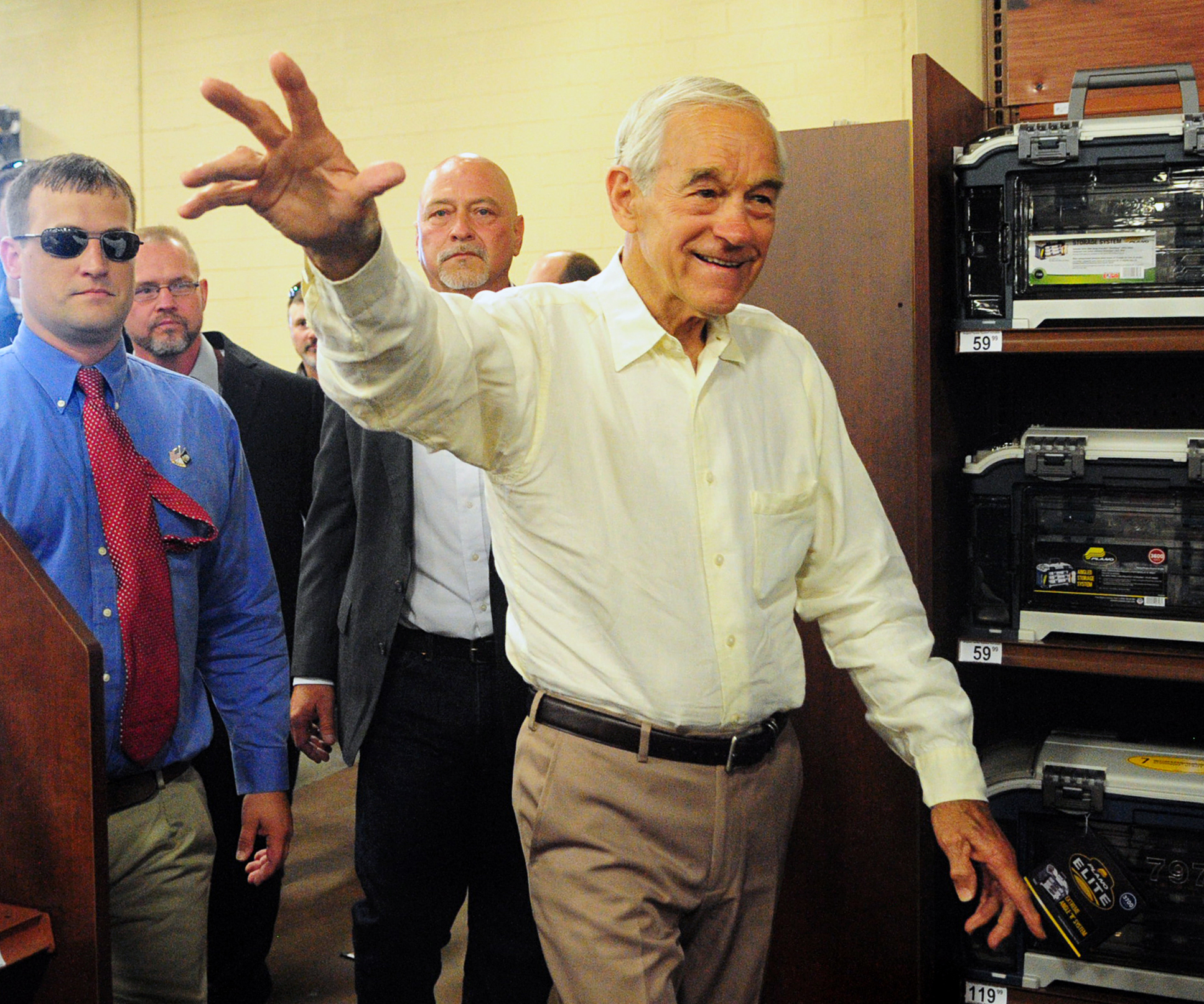 Former U.S. Rep. and presidential candidate Ron Paul waves to supporters before speaking at a campaign rally for U.S. Senate candidate Chris McDaniel, Saturday, June 14, 2014, at Gander Mountain in Hattiesburg, Miss.