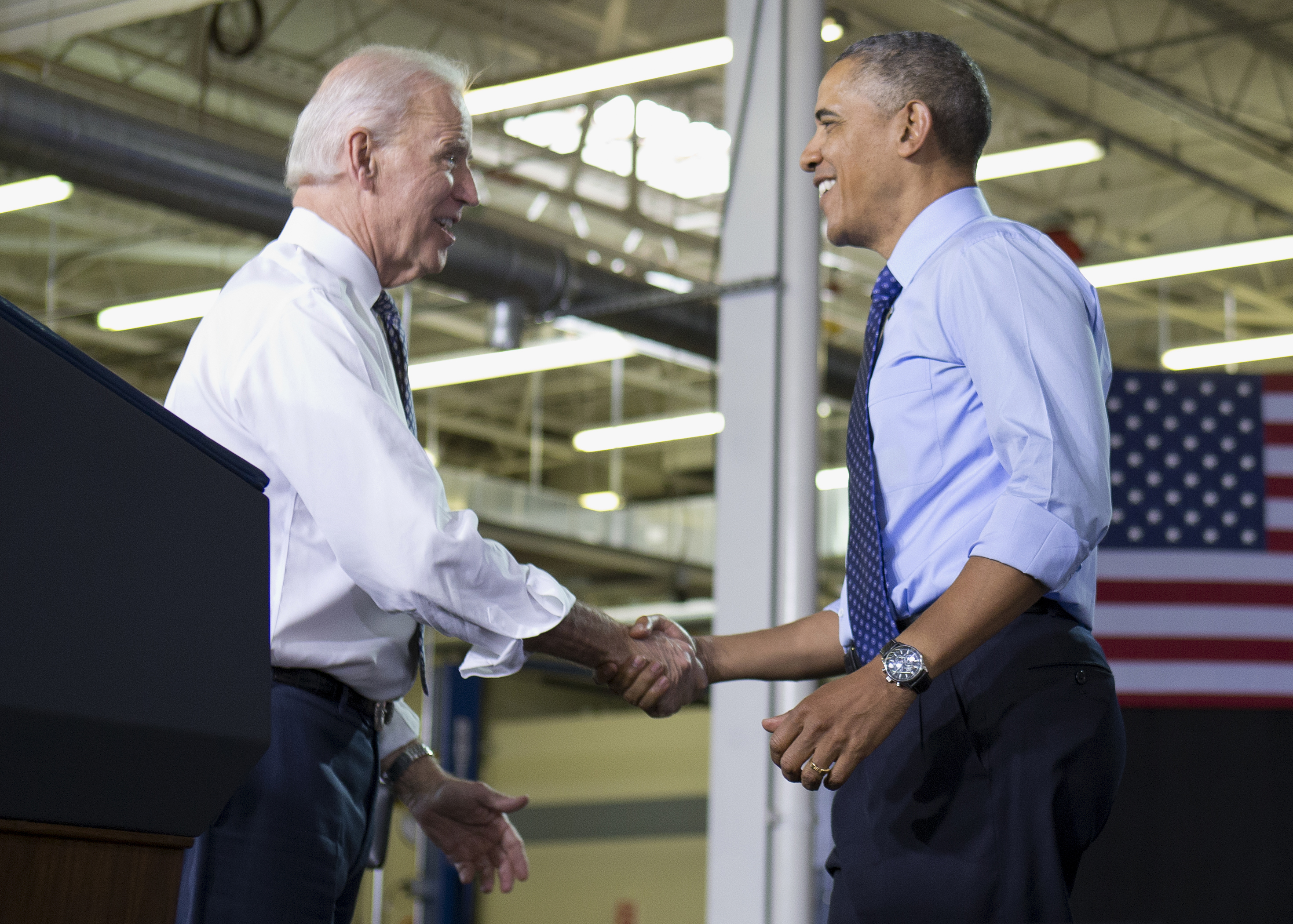 Vice President Joe Biden greets President Barack Obama as he arrives to speak at Community College of Allegheny County West Hills Center, Wednesday, April 16, 2014, in Oakdale, Pa., about the importance of jobs-driven skills training.