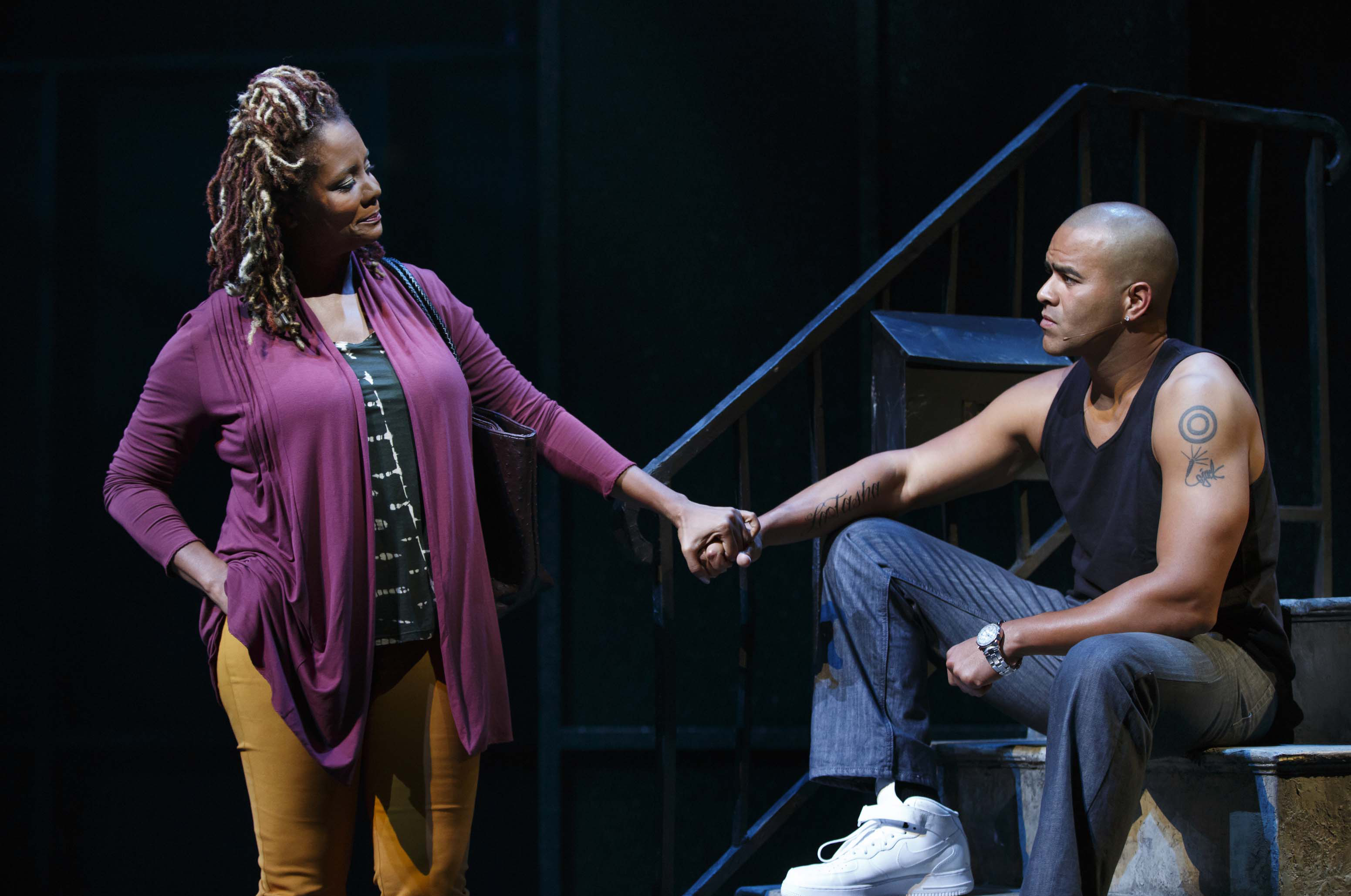 Tonya Pinkins, left, and Christopher Jackson during a performance of  Holler If Ya Hear Me,  at the Palace Theatre in New York.