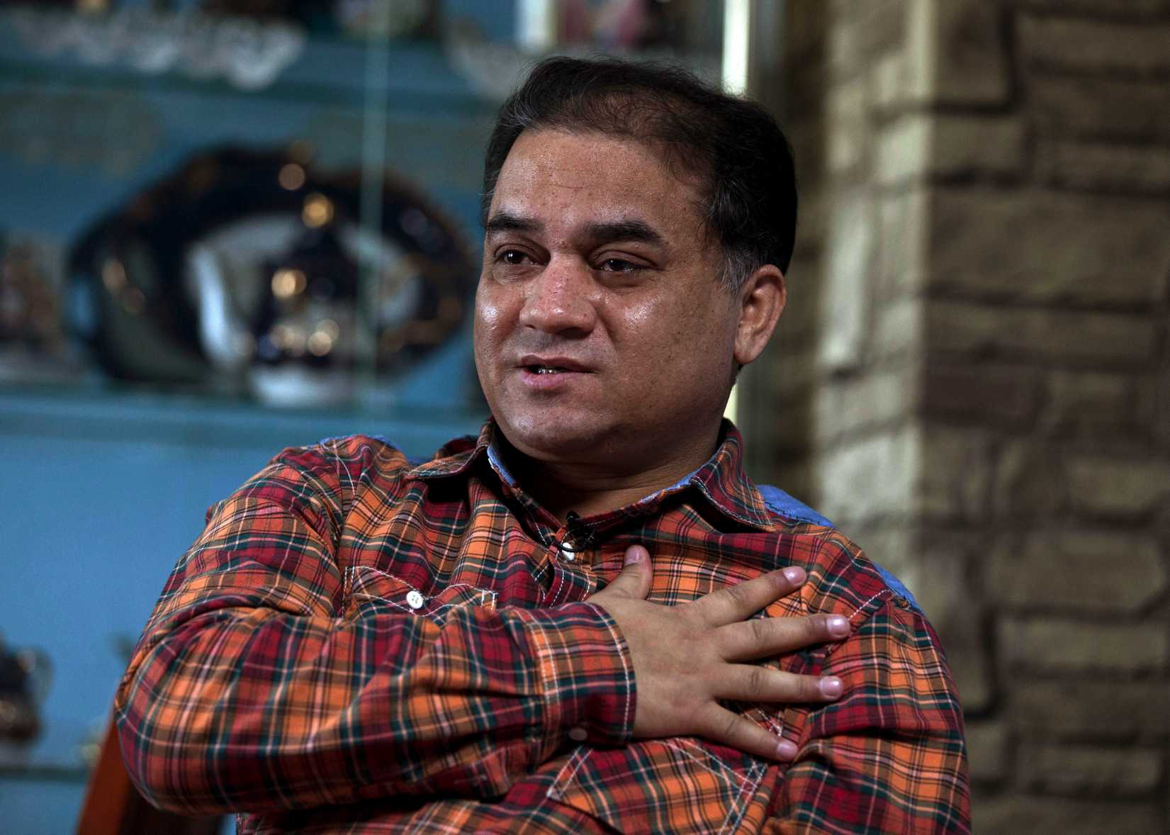 Ilham Tohti, an outspoken scholar of China's Uighur ethnic minority, speaks during an interview at his home in Beijing on Feb. 4, 2013