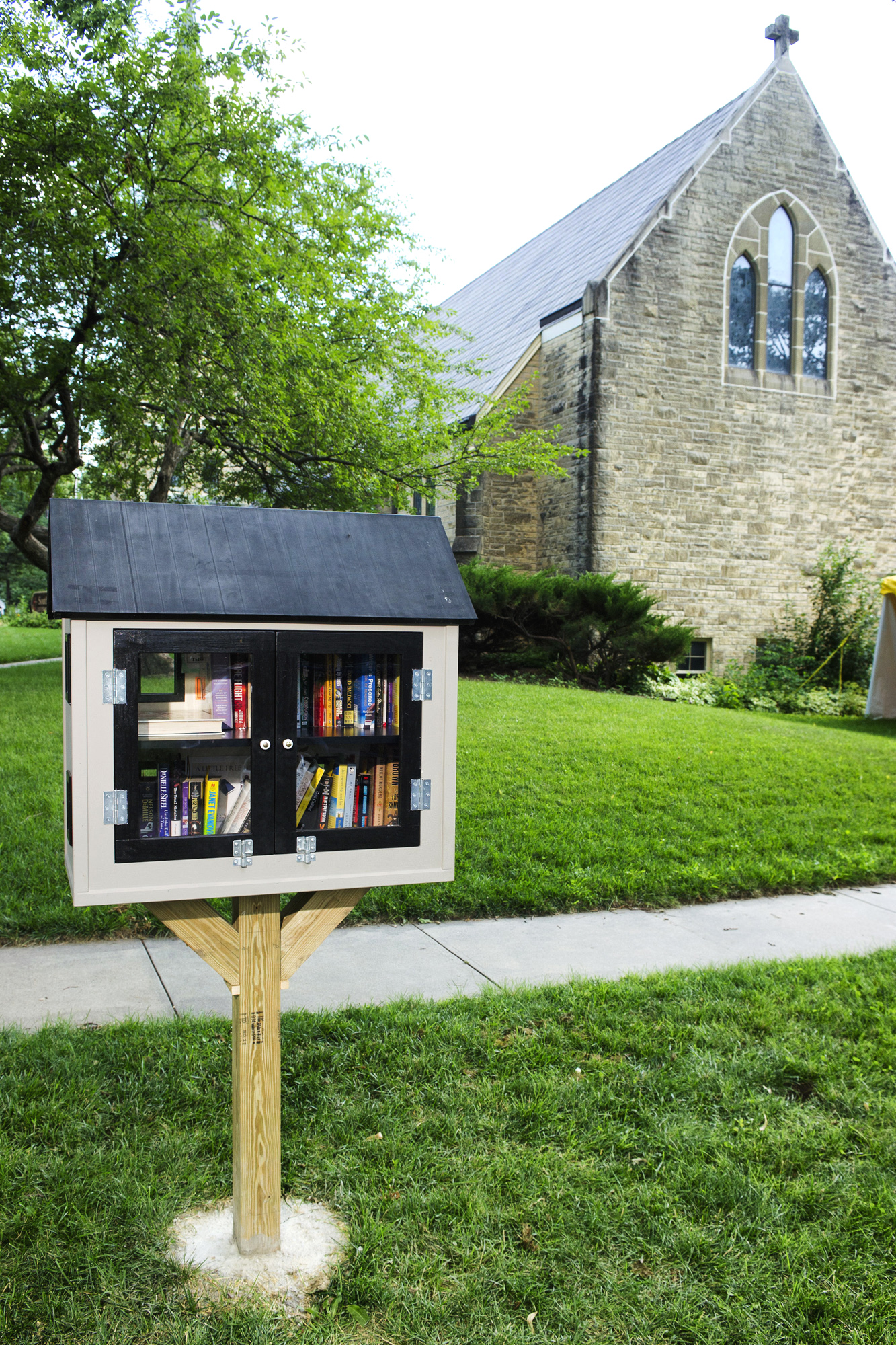 A newly built Little Free Library stands on an area between the sidewalk and the street near Southminster United Methodist Church in the Indian Village neighborhood of Lincoln, Neb., July 8. The city of Lincoln says it can''t sit in a public right of way.