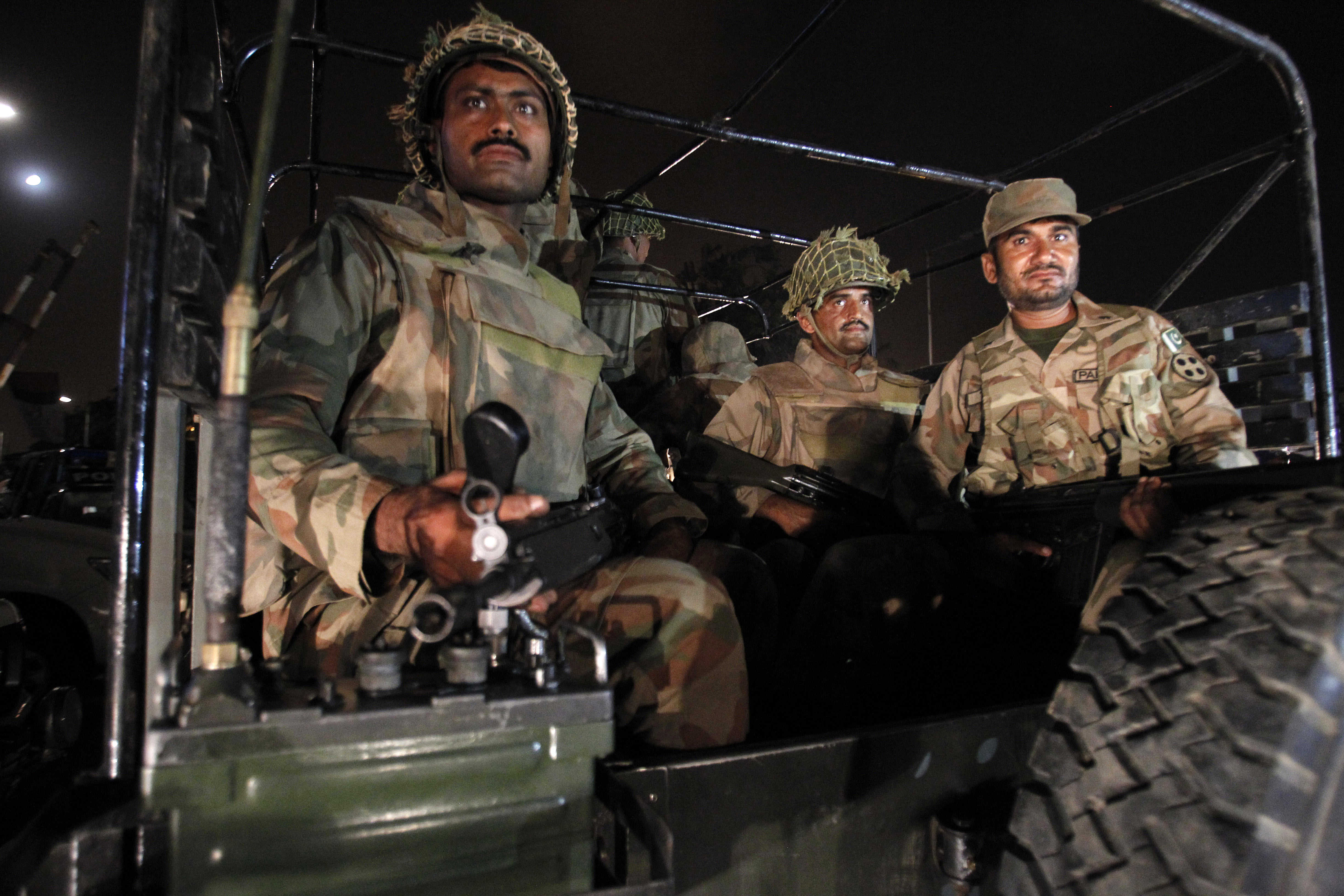 Pakistan army troops arrive at Karachi airport following an attack by unknown gunmen, disguised as police, who stormed a terminal used for VIPs and cargo, Sunday night, June 8, 2014.