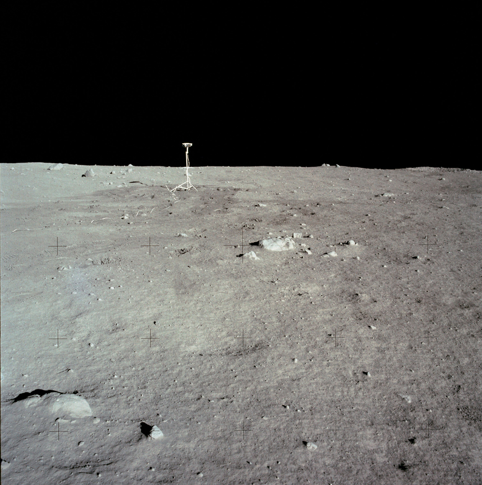 The lunar surface and horizon with the NASA TV camera visible just left of center.