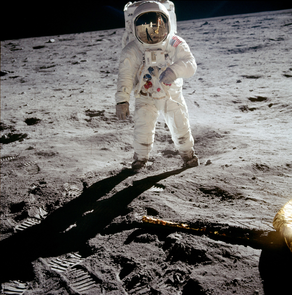 No other Apollo photograph has been reproduced as often as this portrait of Buzz. Neil is, of course, visible in reflection on Buzz's visor. Buzz has his left arm raised and is probably reading the checklist sewn on the wrist cover of his glove.