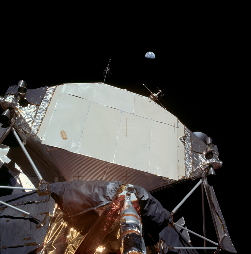 View of Earth over the Lunar Module. There is some uncertainty about who took these pictures of Earth. Australia is visible in sunlight on the left side of the Earth.