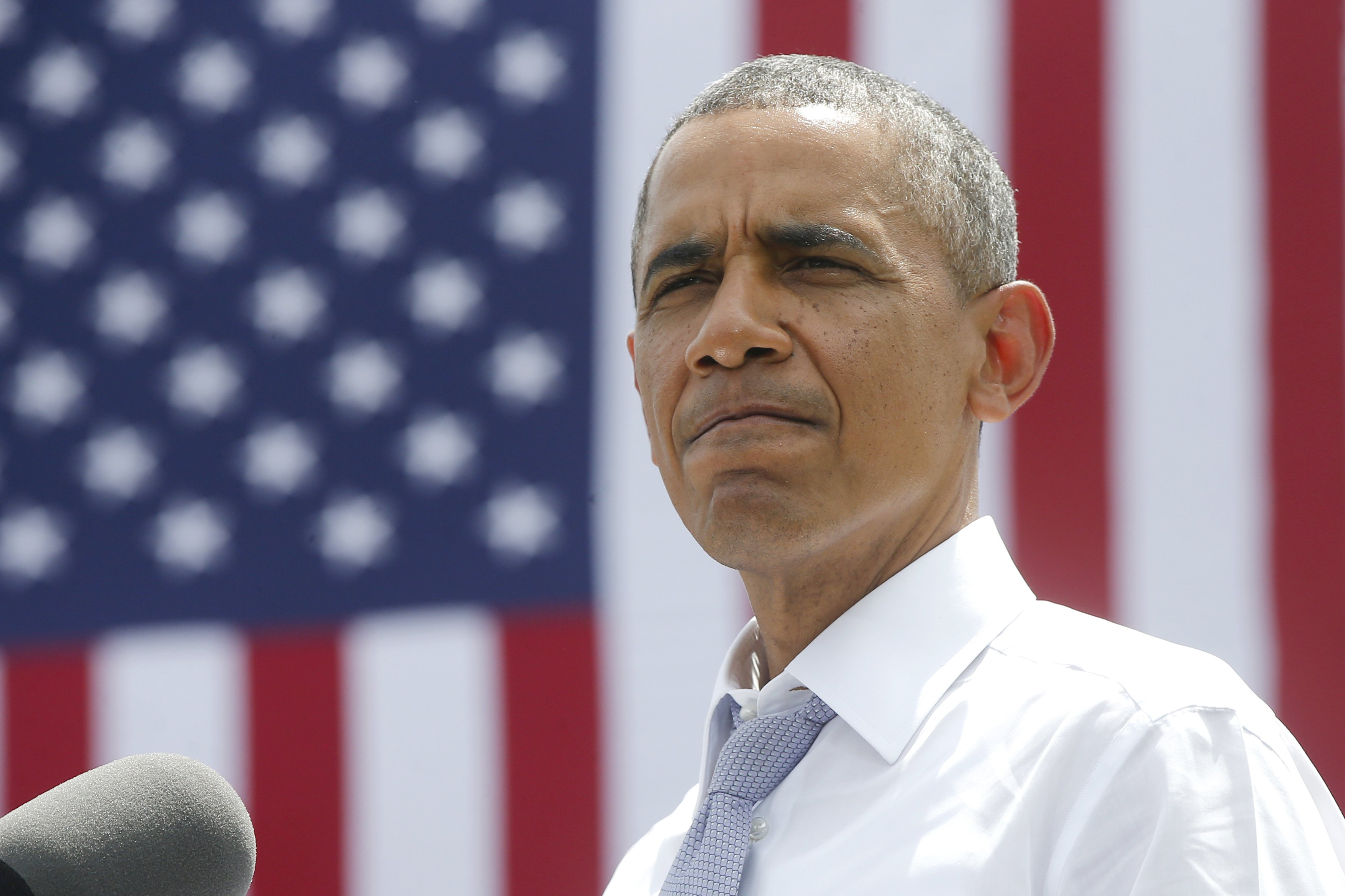 President Barack Obama pauses while speaking about transportation and the economy on July 1, 2014, at the Georgetown Waterfront Park in Washington.